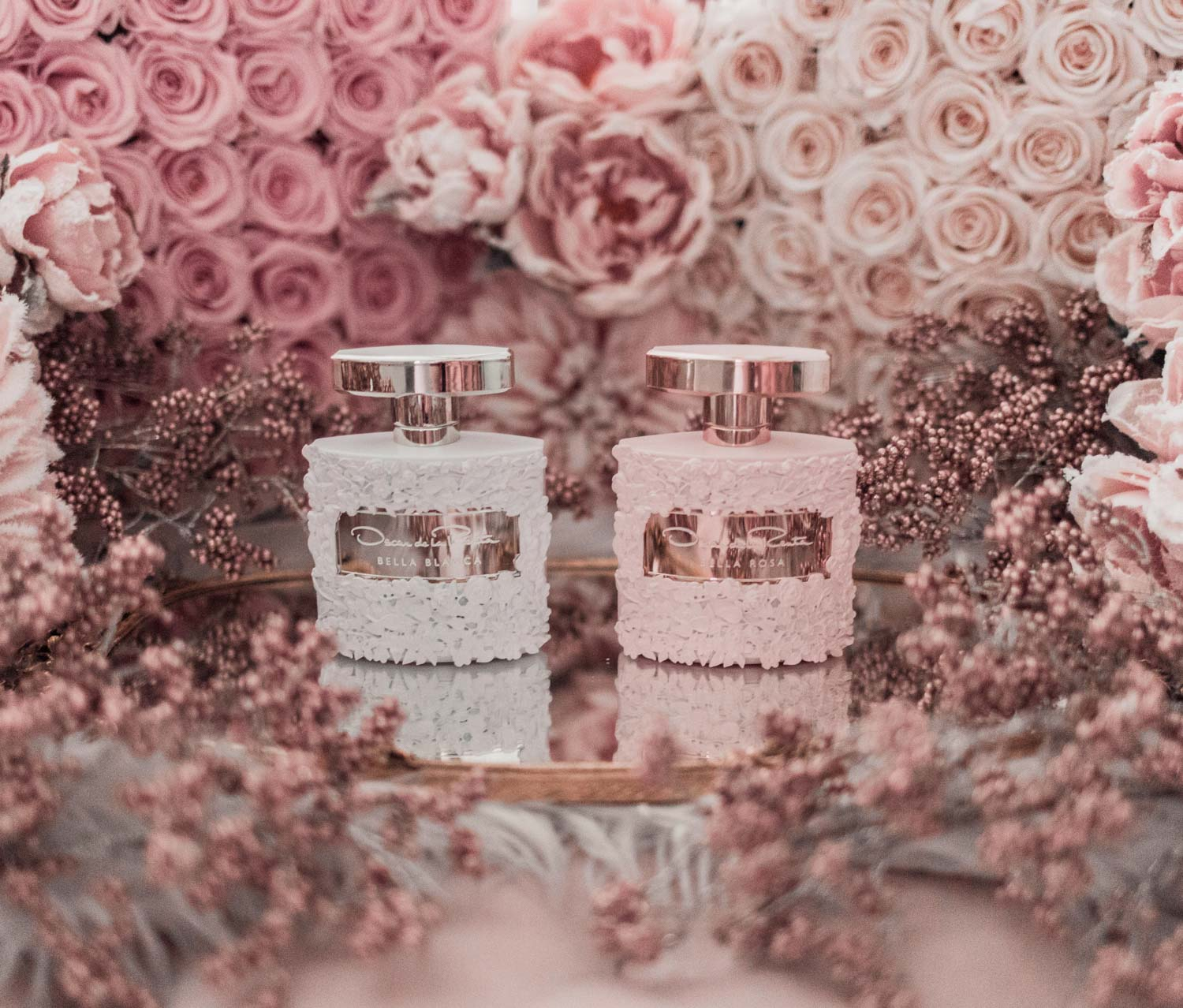 Feminine fashion blogger Elizabeth Hugen of Lizzie in Lace shares the best feminine perfumes and her girly fragrance collection including Oscar de la Renta Bella Blanca and Bella Rosa