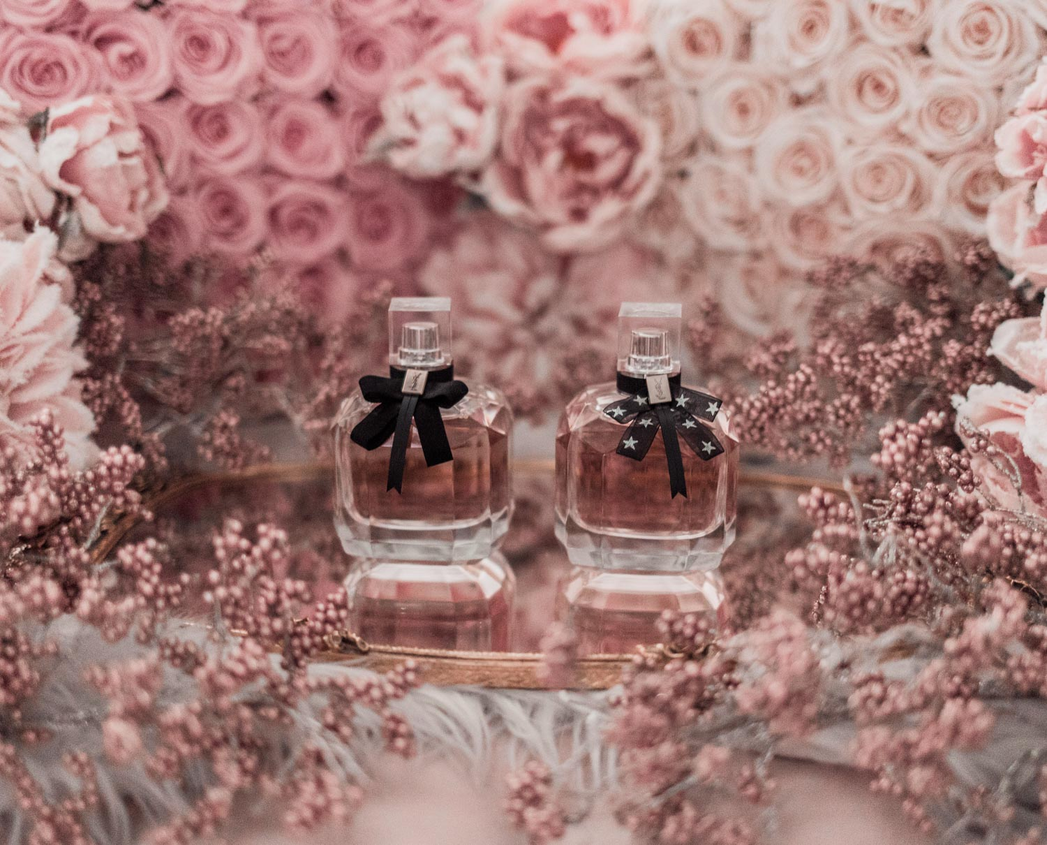 Feminine fashion blogger Elizabeth Hugen of Lizzie in Lace shares the best feminine perfumes and her girly fragrance collection including YSL Mon Paris