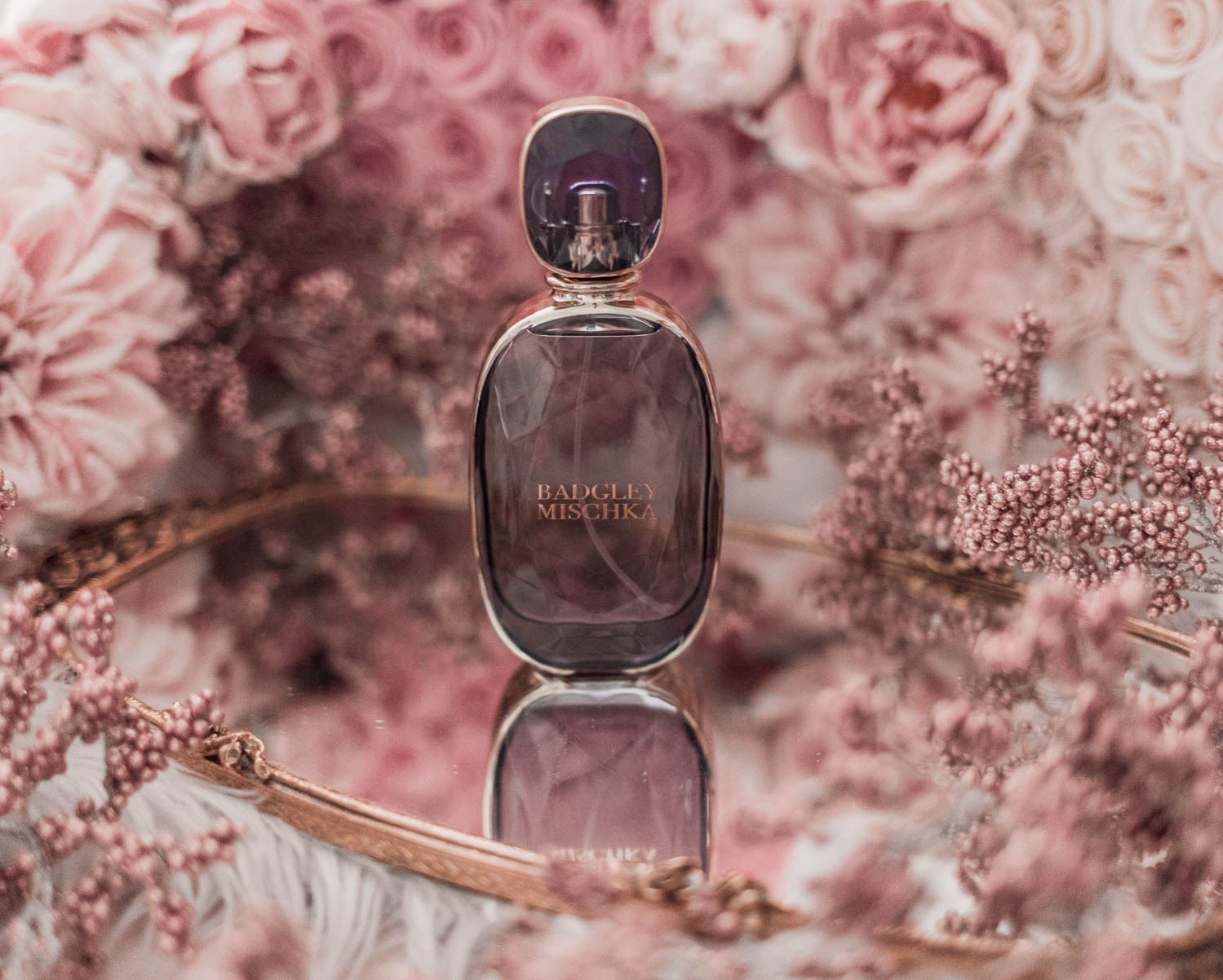 Feminine fashion blogger Elizabeth Hugen of Lizzie in Lace shares the best feminine perfumes and her girly fragrance collection including Badgley Mischka perfume