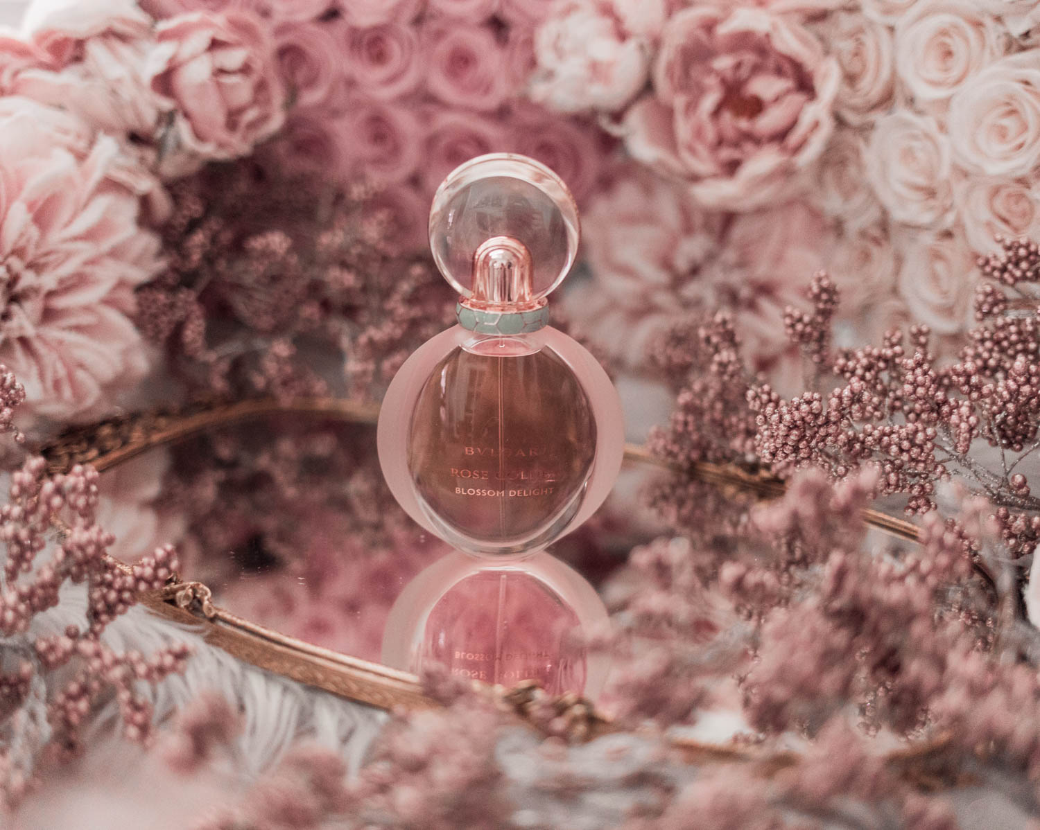Feminine fashion blogger Elizabeth Hugen of Lizzie in Lace shares the best feminine perfumes and her girly fragrance collection including Bulgari Rose Goldea Blossom Delight