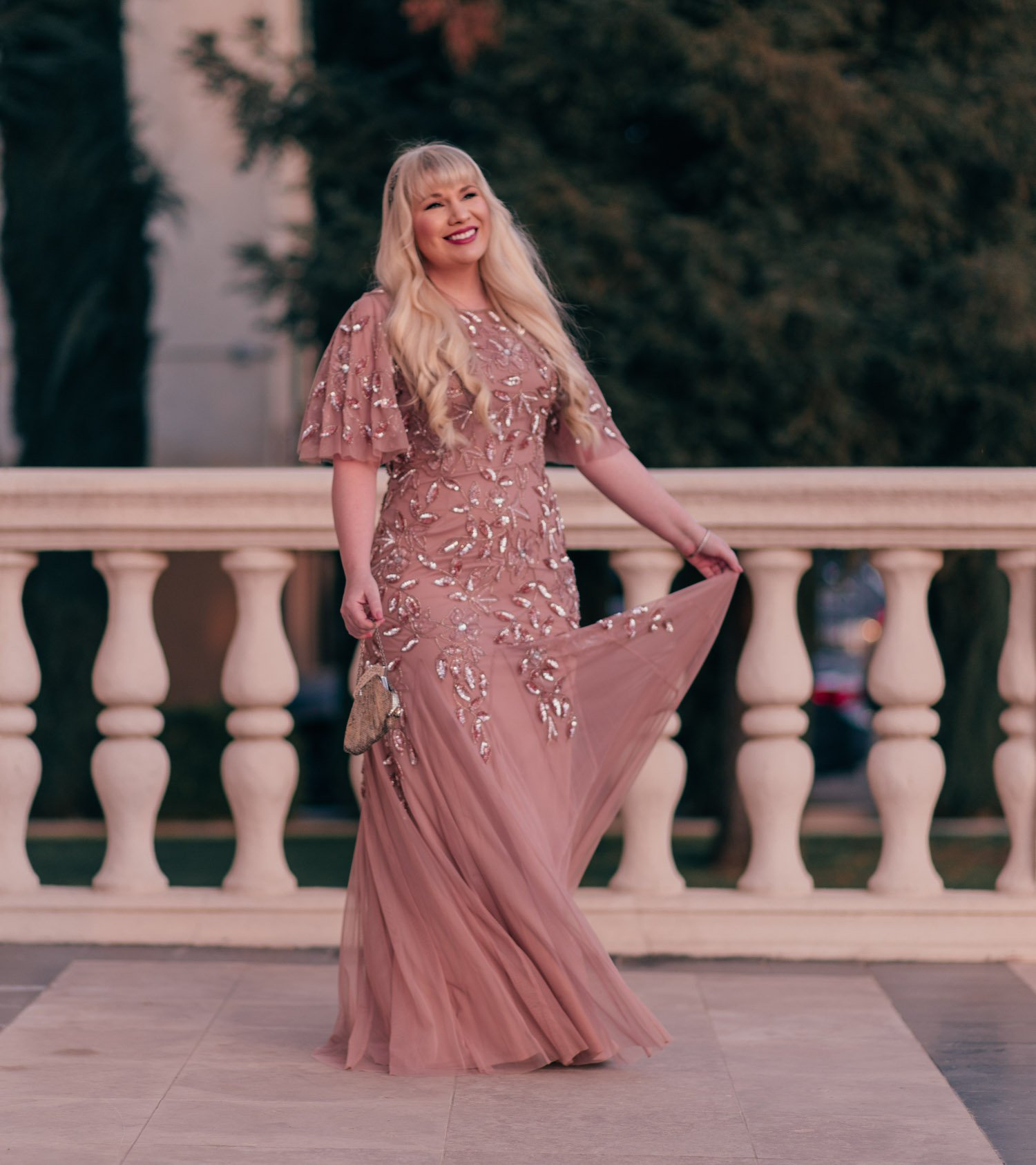 Feminine Fashion Blogger Elizabeth Hugen of Lizzie in Lace shares her 2021 New Years goals and styles a stunning pink tulle Adrianna Papell dress