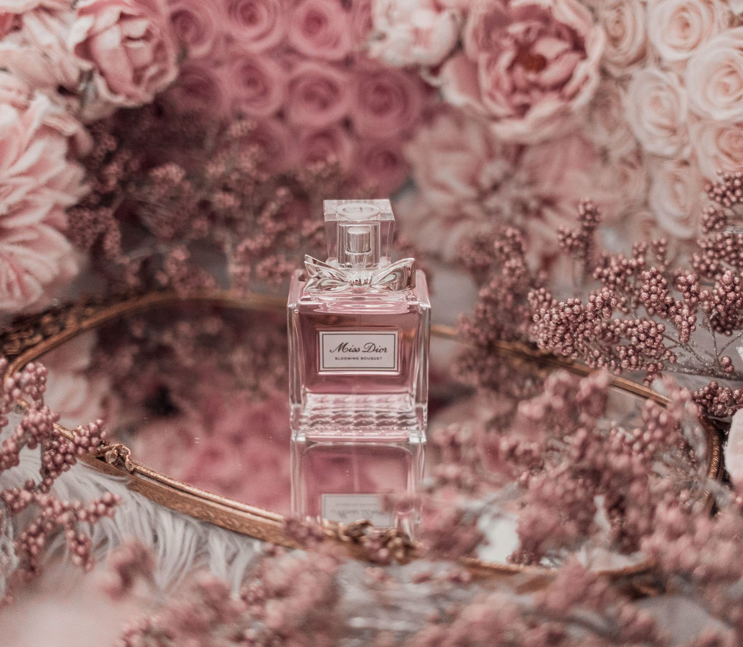 Feminine fashion blogger Elizabeth Hugen of Lizzie in Lace shares the best feminine perfumes and her girly fragrance collection including Dior Miss Dior Blooming Bouquet