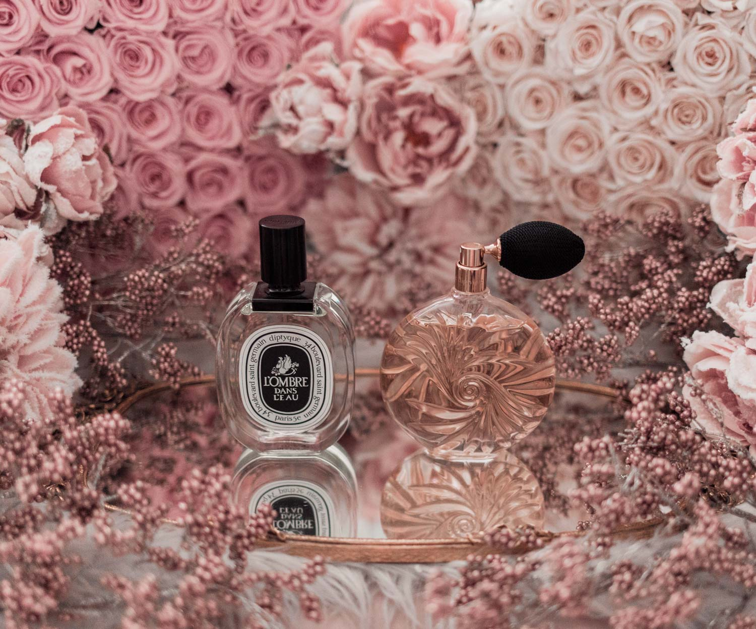 Feminine fashion blogger Elizabeth Hugen of Lizzie in Lace shares the best feminine perfumes and her girly fragrance collection including Diptique L'ombre dans l'eau and essences insensees