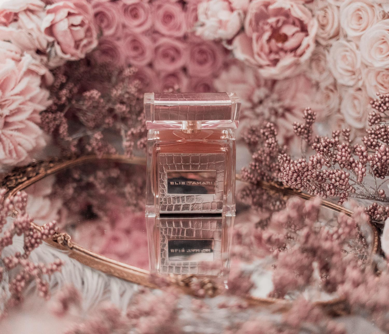 Feminine fashion blogger Elizabeth Hugen of Lizzie in Lace shares the best feminine perfumes and her girly fragrance collection including Elie Tahari perfume