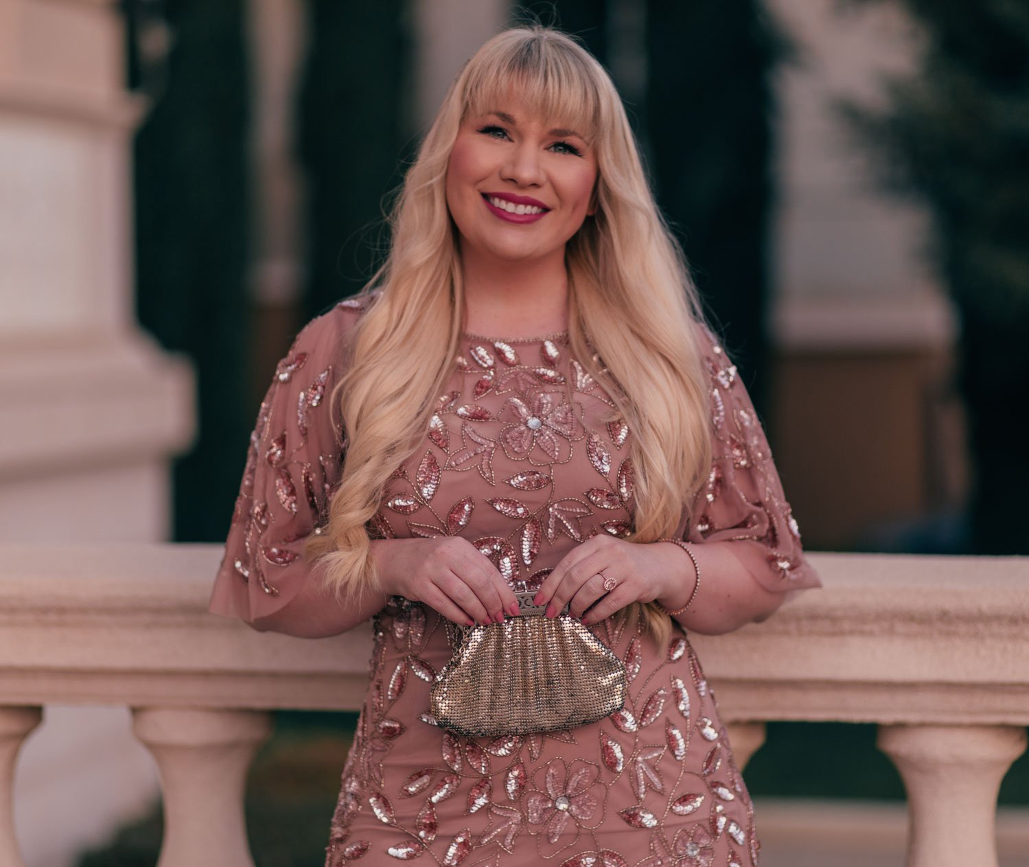 Feminine Fashion Blogger Elizabeth Hugen of Lizzie in Lace shares her 2021 New Years goals and styles a stunning pink tulle Adrianna Papell dress and vintage Whiting and Davis bag
