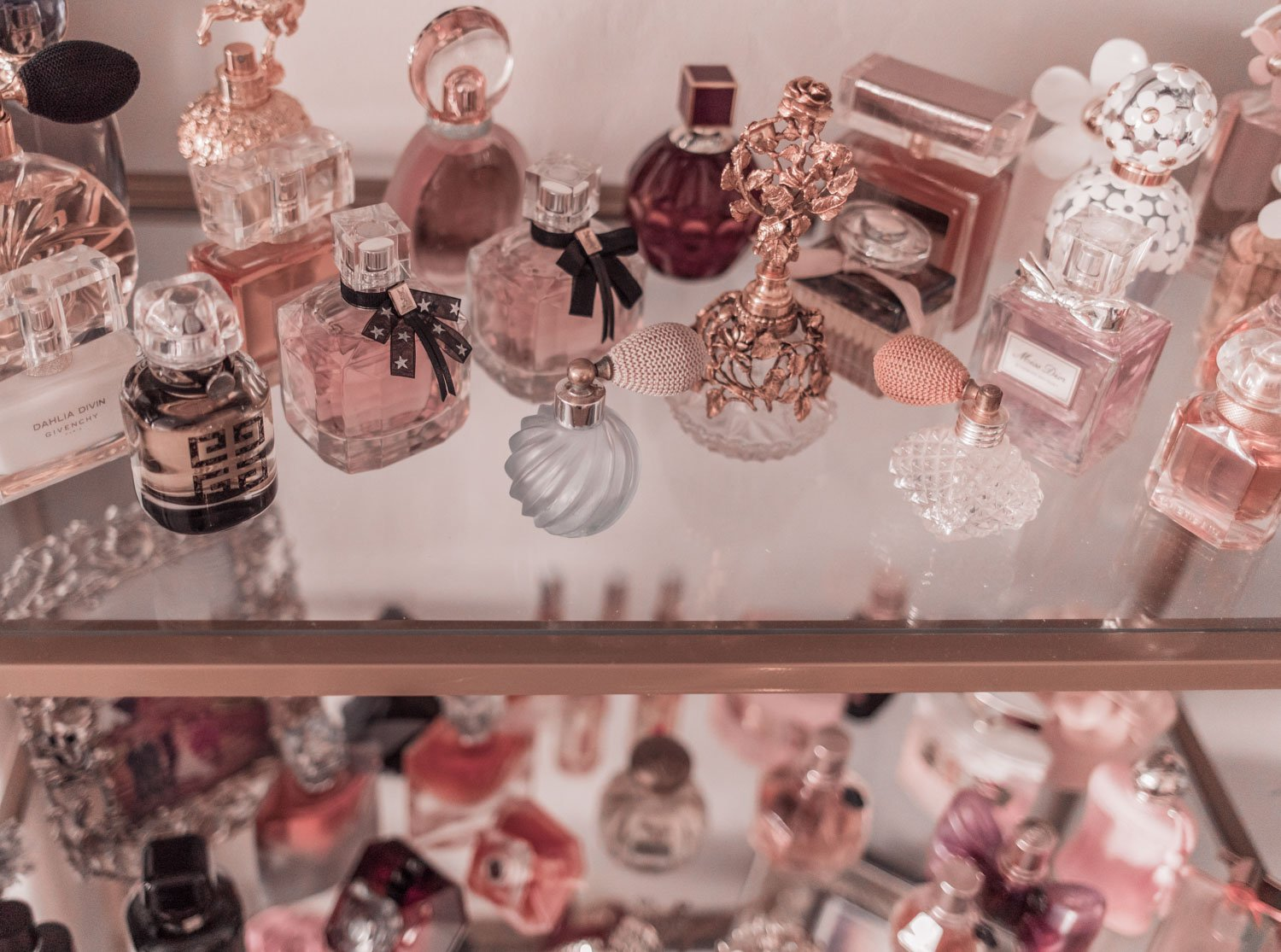 Feminine fashion blogger Elizabeth Hugen of Lizzie in Lace shares the best feminine perfumes and her girly fragrance collection