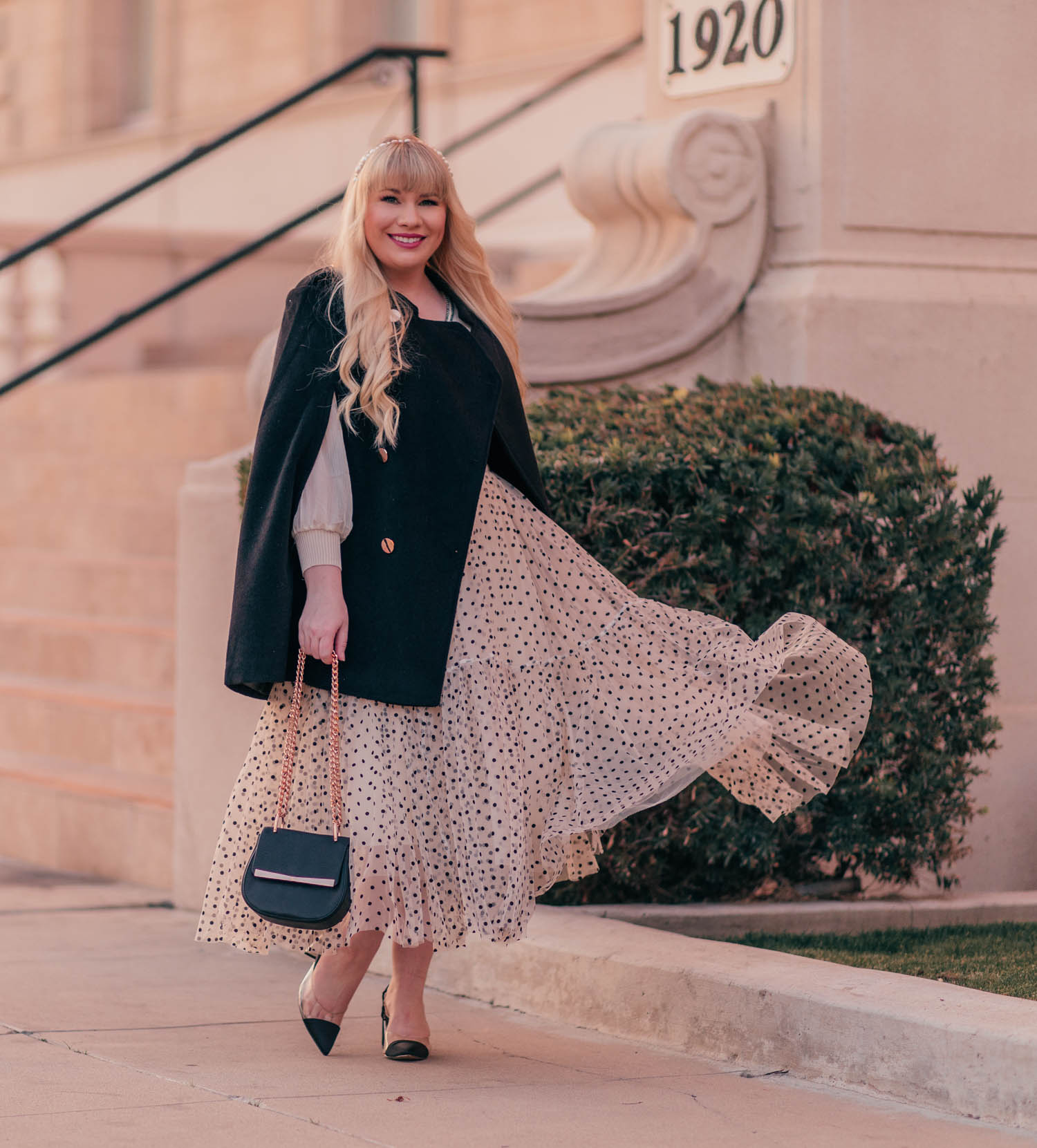 Feminine Fashion Blogger Elizabeth Hugen shares two ways to wear a polka dot tulle skirt outfit including with a chic black cape