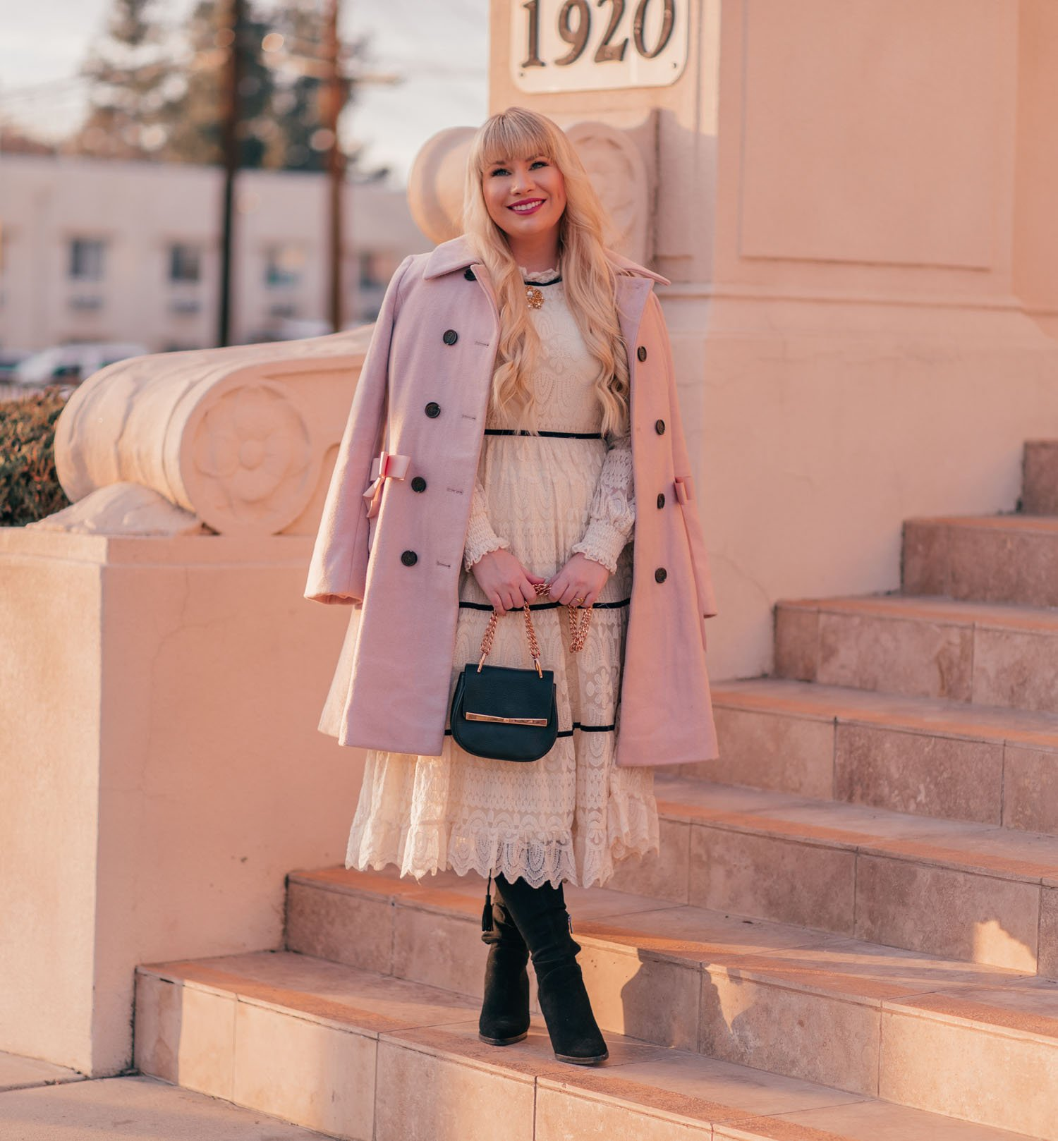 Feminine Fashion Blogger Elizabeth Hugen of Lizzie in Lace shares a girly Valentine's Day Outfit with a pink coat and white lace Chicwish dress along with her January 2021 Month in Review
