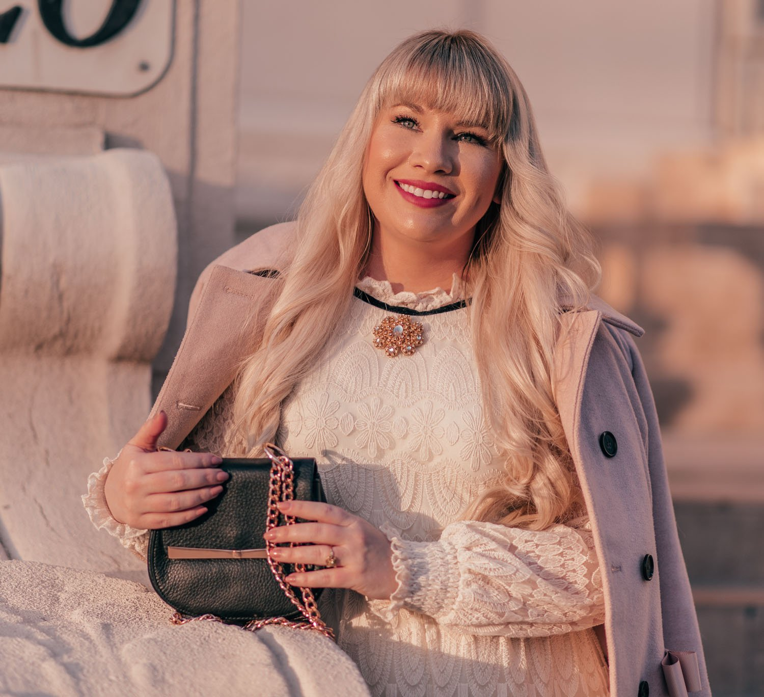Feminine Fashion Blogger Elizabeth Hugen of Lizzie in Lace shares a girly Valentine's Day Outfit with a pink coat and white lace Chicwish dress with a Givenchy brooch from Obanj