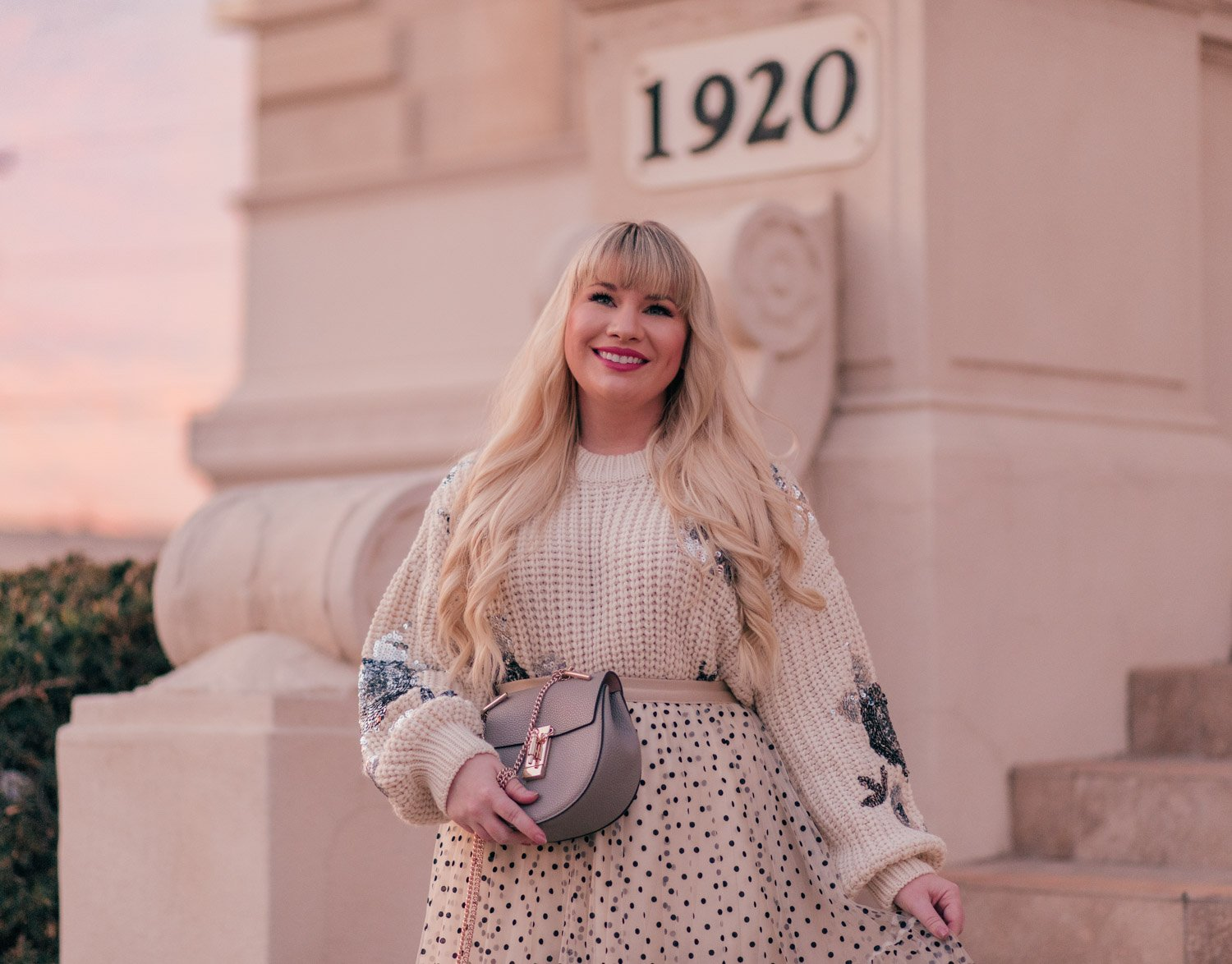 Feminine Fashion Blogger Elizabeth Hugen shares two ways to wear a polka dot tulle skirt outfit including with an oversized sweater