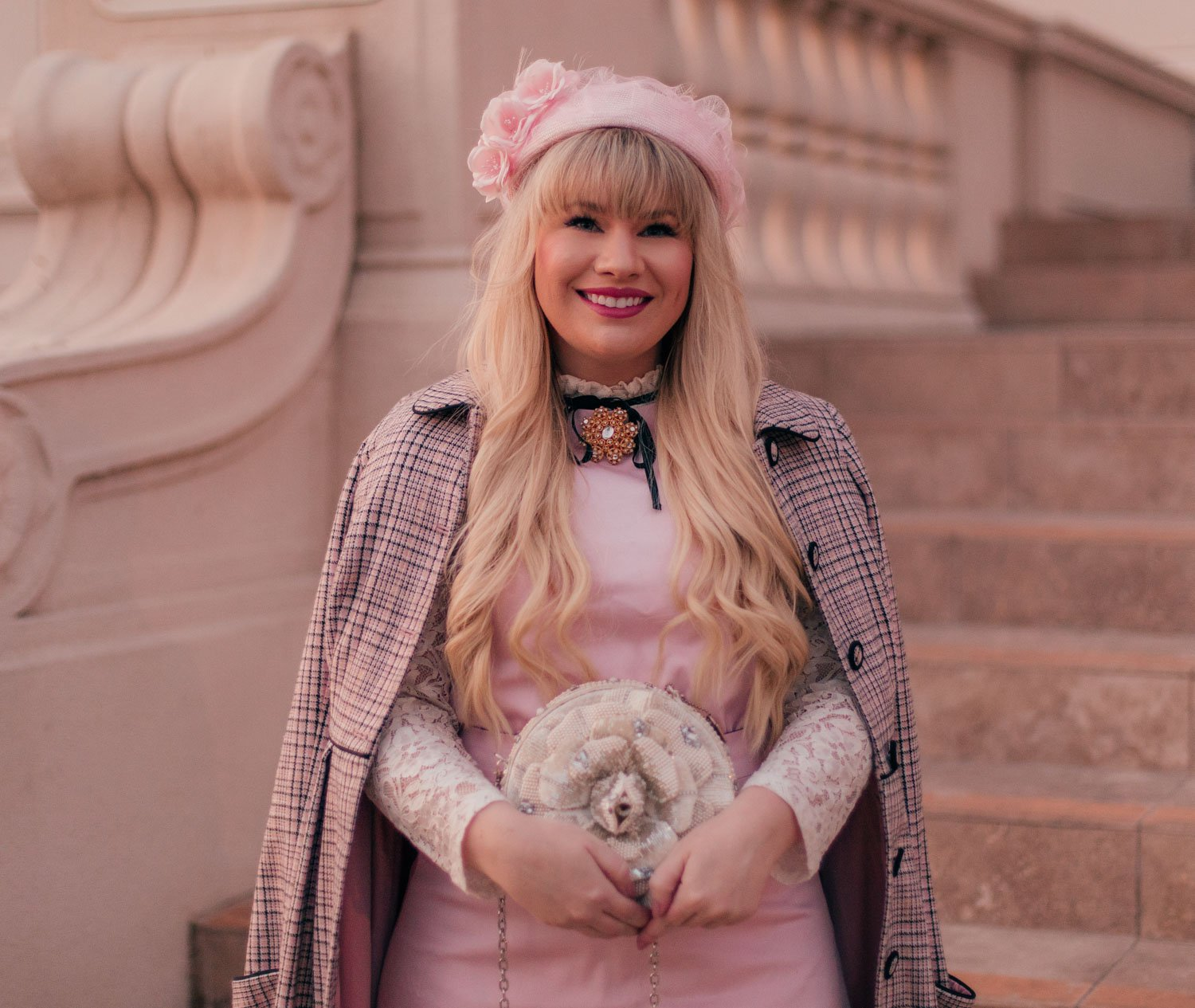 Feminine Fashion Blogger Elizabeth Hugen of Lizzie in Lace wears a girly vintage aesthetic outfit for spring with a pink pillbox hat