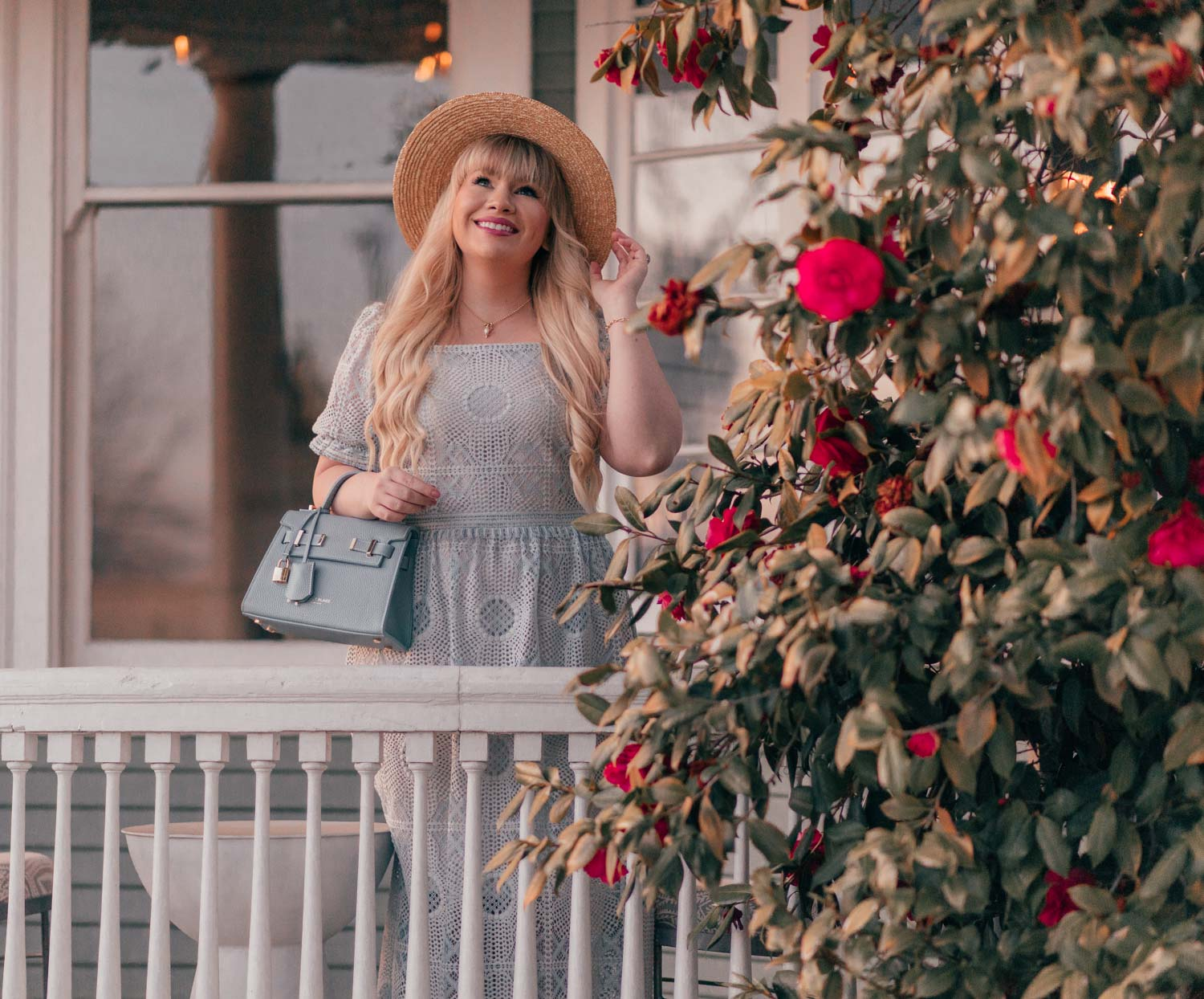 Girly Fashion Blogger Elizabeth Hugen of Lizzie in Lace shares a Feminine Cottagecore Outfit Idea for Spring including this light blue lace Elie Tahari dress