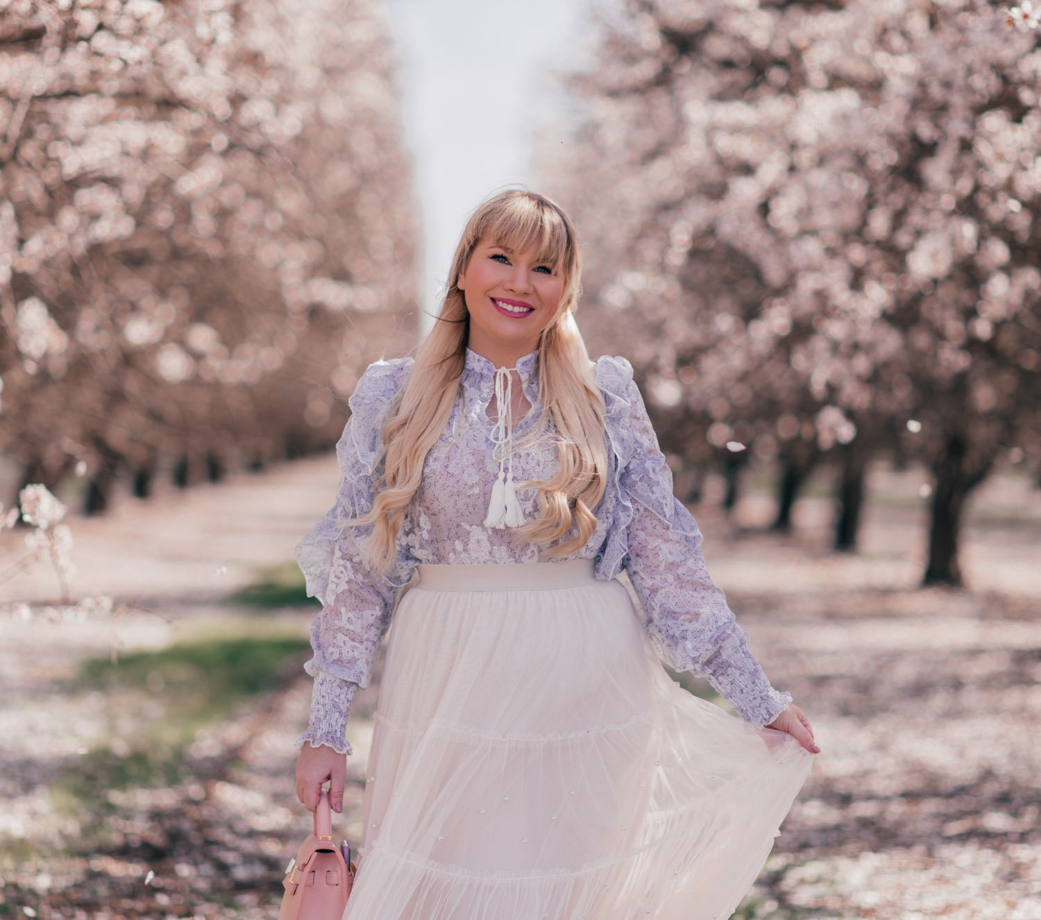 Fashion Blogger Elizabeth Hugen styles a Feminine Easter Outfit for Spring with a Chicwish ruffled top and tulle skirt and Teddy Blake handbag
