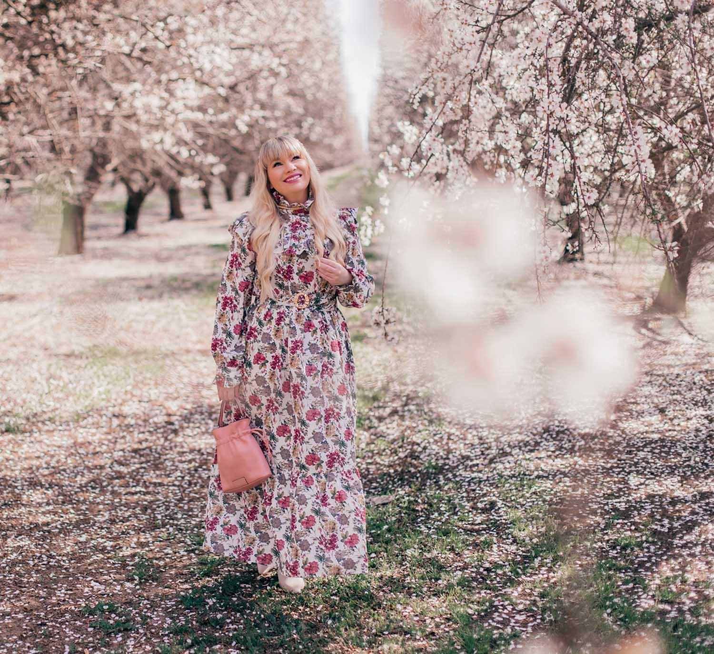 Feminine Fashion Blogger Elizabeth Hugen styles a floral Sister Jane dress for spring