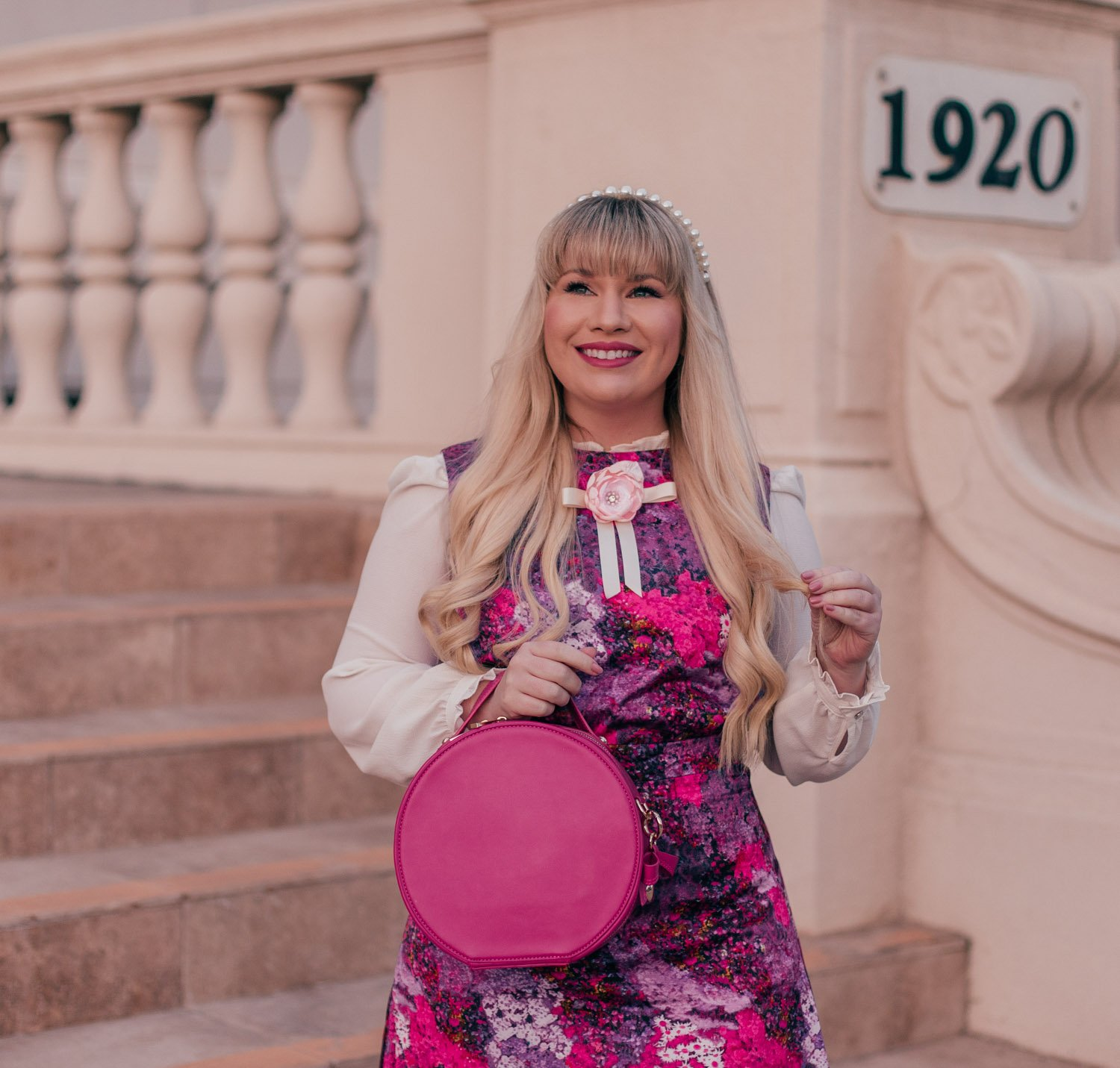 Feminine Fashion Blogger Elizabeth Hugen of Lizzie in Lace wears a hot pink girly outfit for spring and pearl headband