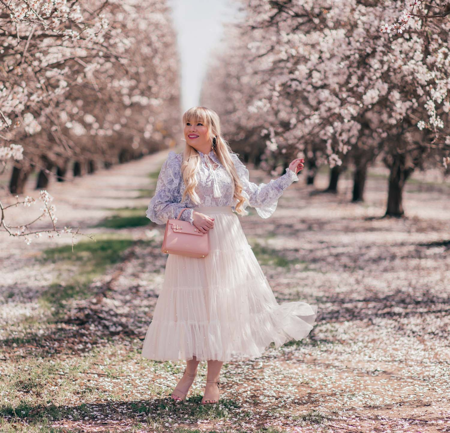 Fashion Blogger Elizabeth Hugen styles a Feminine Easter Outfit for Spring with a Chicwish top and tulle skirt and Teddy Blake handbag