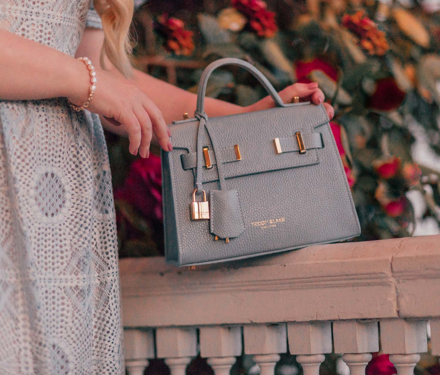 Girly Fashion Blogger Elizabeth Hugen of Lizzie in Lace shares a Feminine Cottagecore Outfit Idea for Spring including this Teddy Blake Ava Bag