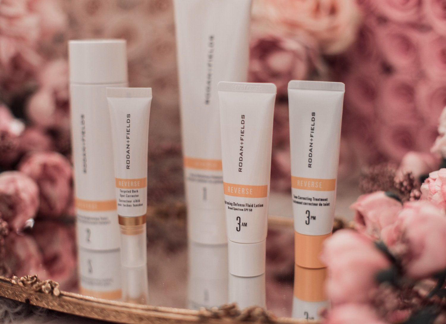 Fashion and beauty blogger Elizabeth Hugen of Lizzie in Lace shares her skincare routine for dark spot removal featuring the Rodan + Fields REVERSE Regimen