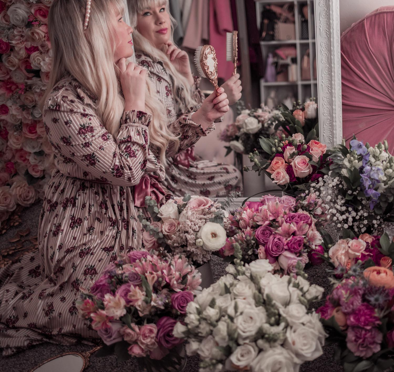 Feminine Fashion Blogger Elizabeth Hugen of Lizzie in Lace wears a floral Sister Jane dress and shares her gorgeous feminine home decor including spring flowers from Urban Stems
