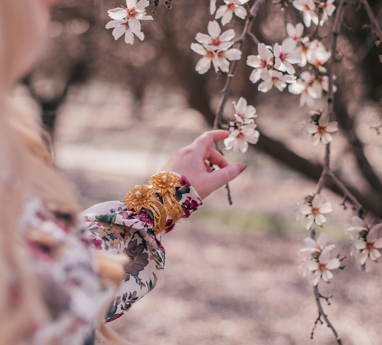 Feminine Fashion Blogger Elizabeth Hugen styles a floral Sister Jane dress for spring with Ana Carolina Valencia jewelry
