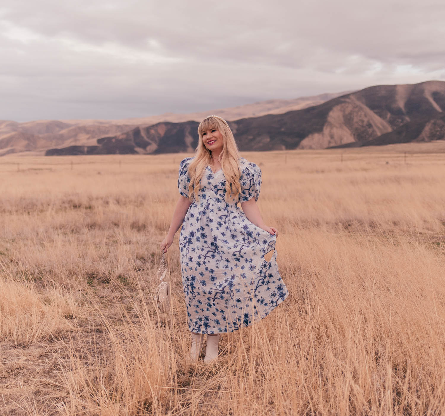 Feminine fashion blogger Elizabeth Hugen of Lizzie in Lace wears a beautiful white and blue floral dress for spring and shares an interview with Syra J.