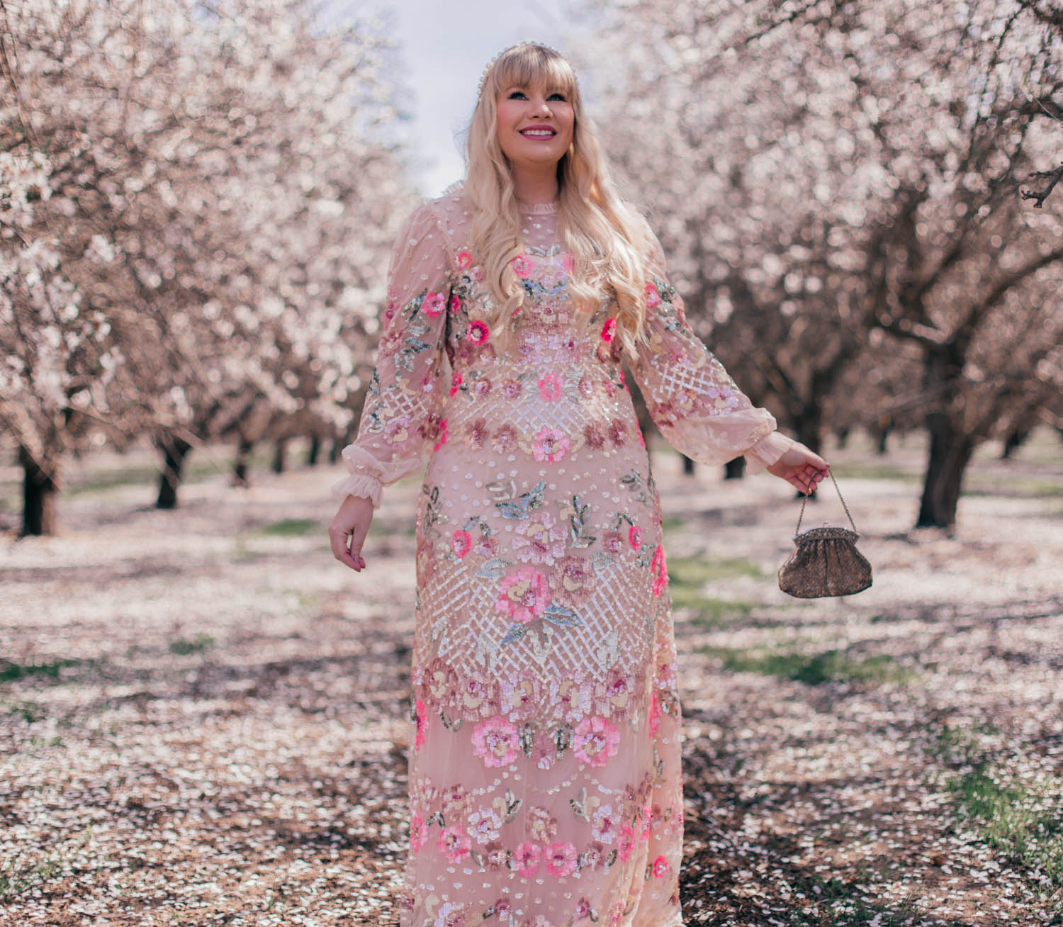 Feminine Fashion Blogger Elizabeth Hugen of Lizzie in Lace wears a tulle floral Needle and Thread Dress to celebrate her six year blogging anniversary