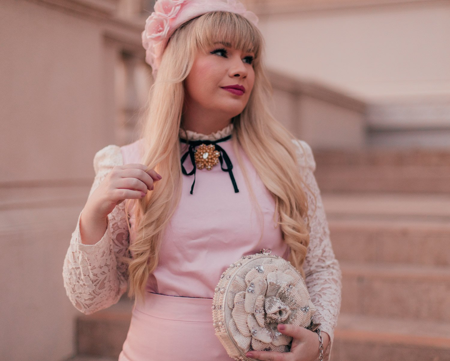 Feminine Fashion Blogger Elizabeth Hugen of Lizzie in Lace wears a girly vintage aesthetic outfit for spring with a vintage Givenchy brooch