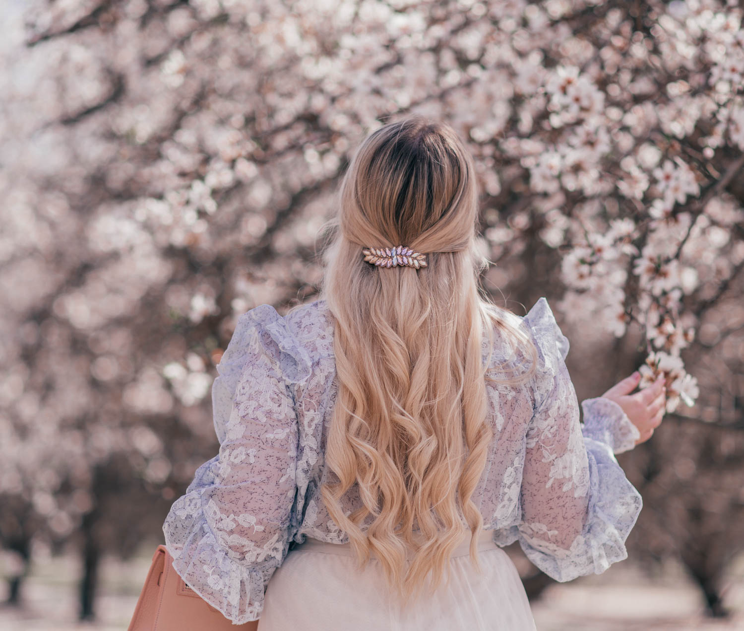 Fashion Blogger Elizabeth Hugen styles a Feminine Easter Outfit for Spring with a Chicwish top and tulle skirt and Alexandre de Paris hair barrette