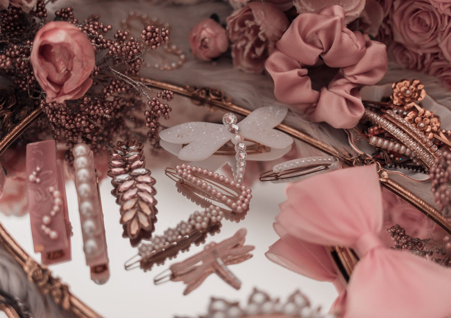 Feminine Fashion Blogger Elizabeth Hugen of Lizzie in Lace shares her girly hair accessories collection