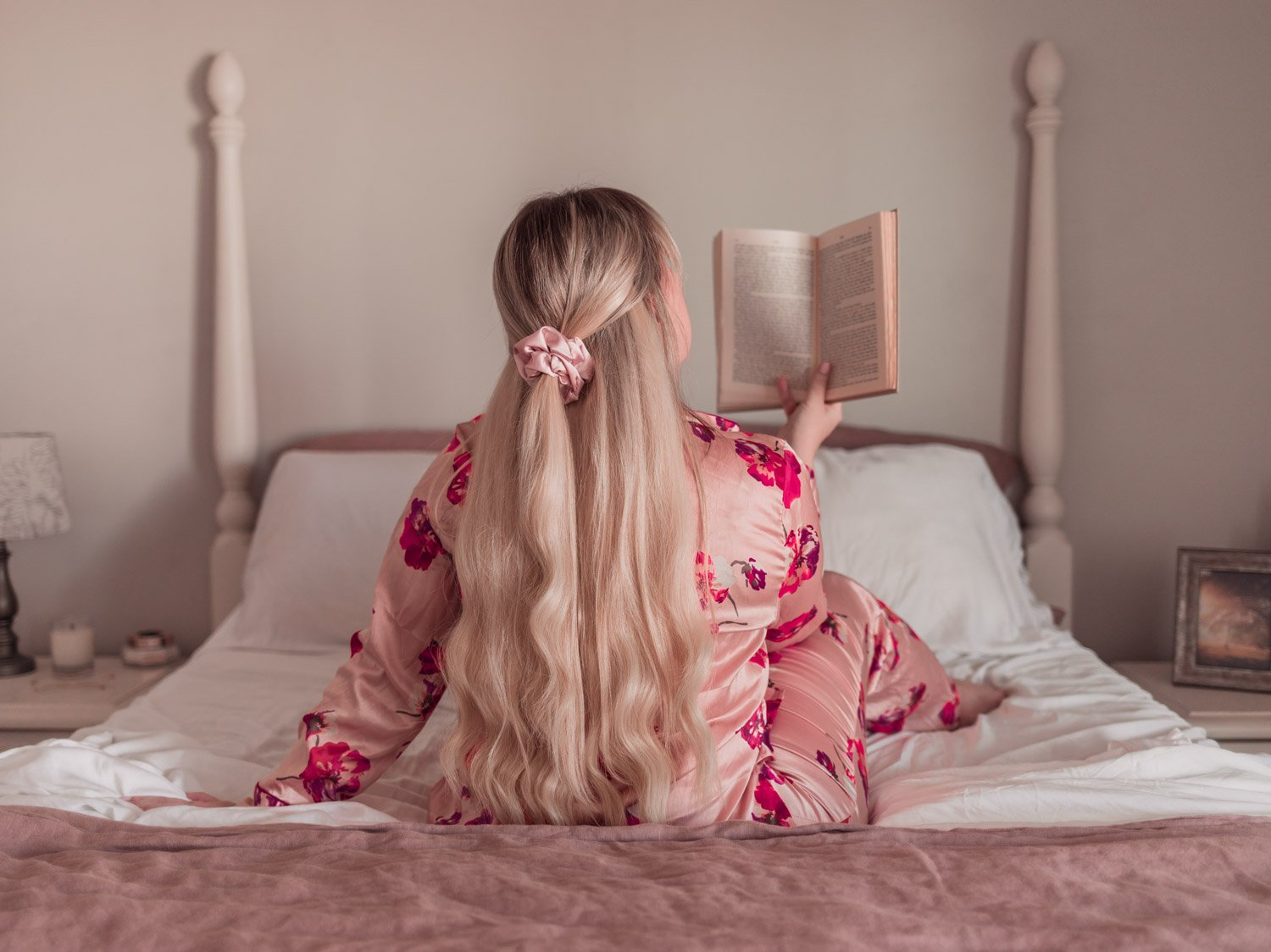 Feminine Fashion Blogger Lizzie in Lace wear silk floral pajamas and shares her honest thoughts about bamboo sheets in her Cosy House vs Cozy Earth Sheets Review