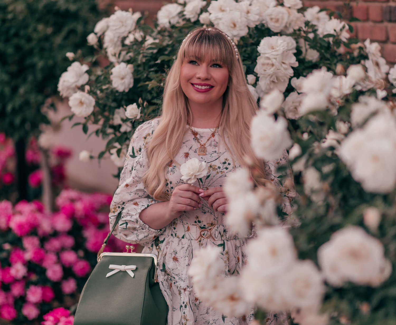 Feminine fashion blogger Elizabeth Hugen of Lizzie in Lace shares her spring 2021 bucket list along with a girly spring outfit idea including this floral Chicwish dress and Sequin Jewelry initial necklace