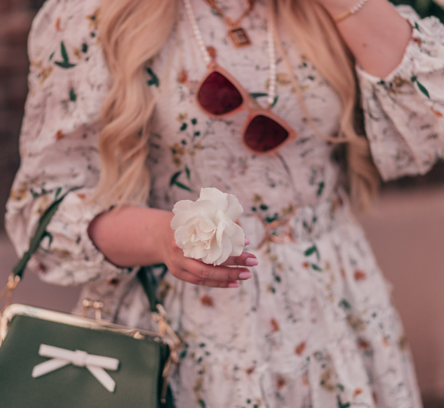 Feminine fashion blogger Elizabeth Hugen of Lizzie in Lace shares her spring 2021 bucket list along with a girly spring outfit idea including this floral Chicwish dress and blush Sunski sunglasses