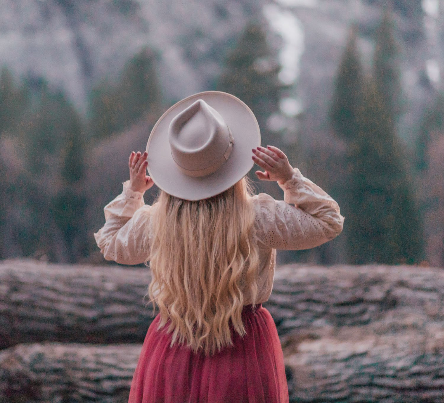 Feminine fashion blogger Elizabeth Hugen of Lizzie in Lace shares her April 2021 Month in Review and a feminine spring outfit with a rose tulle skirt and Gigi Pip Monroe rancher hat
