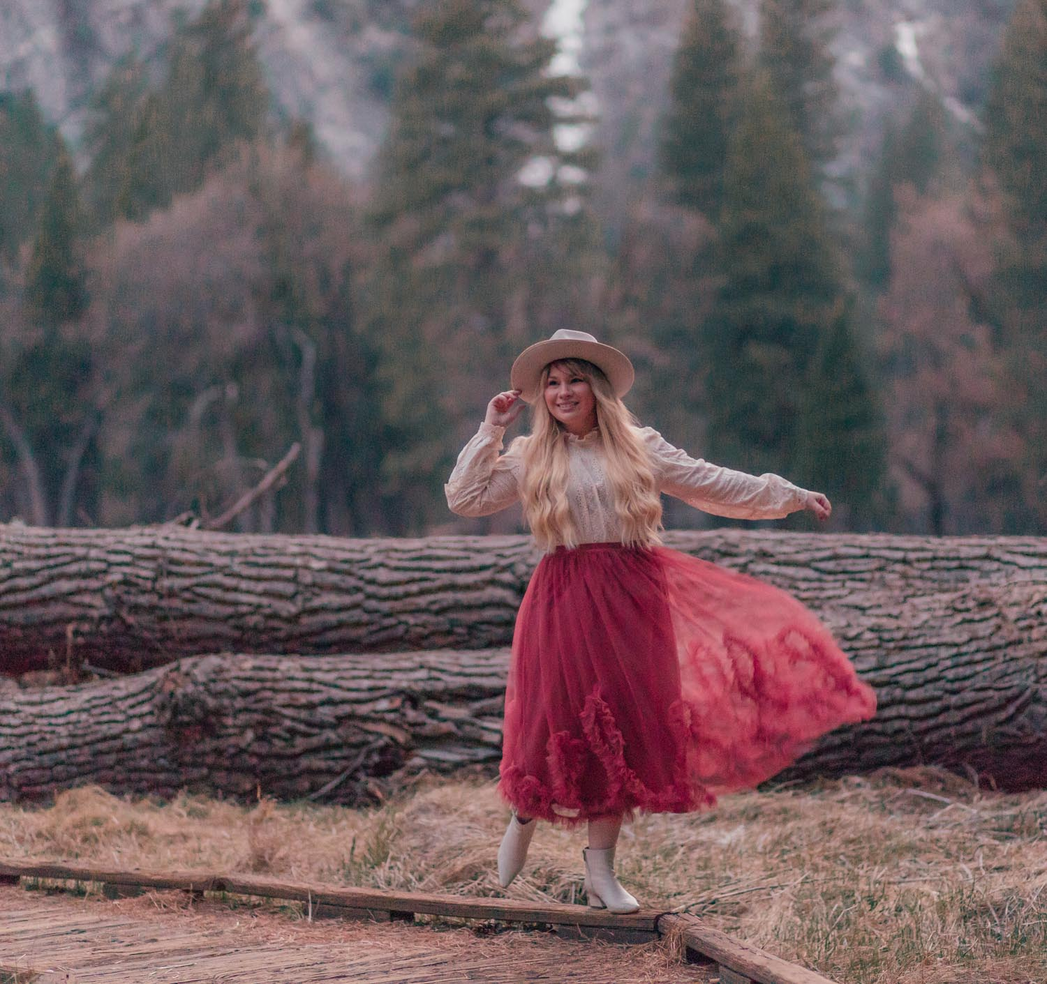 Feminine fashion blogger Elizabeth Hugen of Lizzie in Lace shares her April 2021 Month in Review and a feminine spring outfit with a rose tulle skirt and Gigi Pip Monroe rancher hat in Yosemite National Park