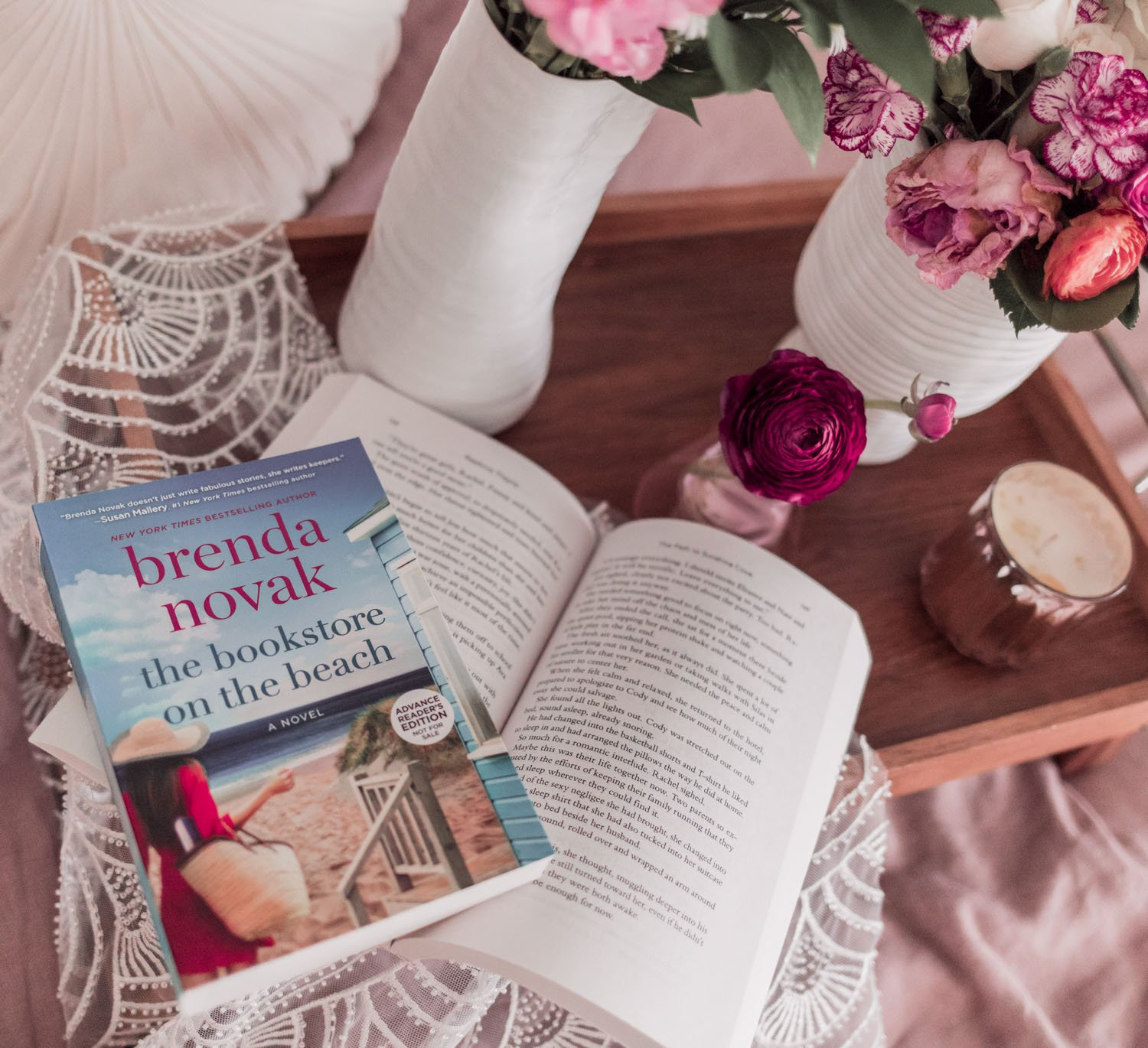 Feminine blogger Elizabeth Hugen of Lizzie in Lace shares her favorite spring books including The Bookstore on the Beach