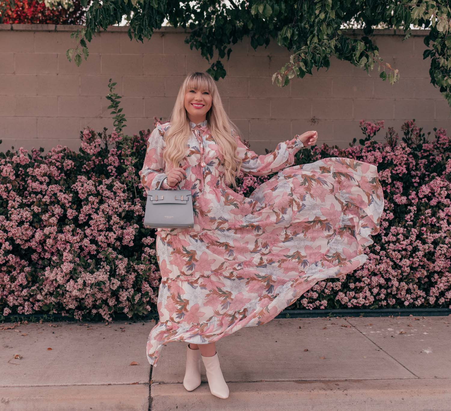 Feminine Fashion Blogger Elizabeth Hugen of Lizzie in Lace styles a Floral Petite Maxi Dress with white boots for spring