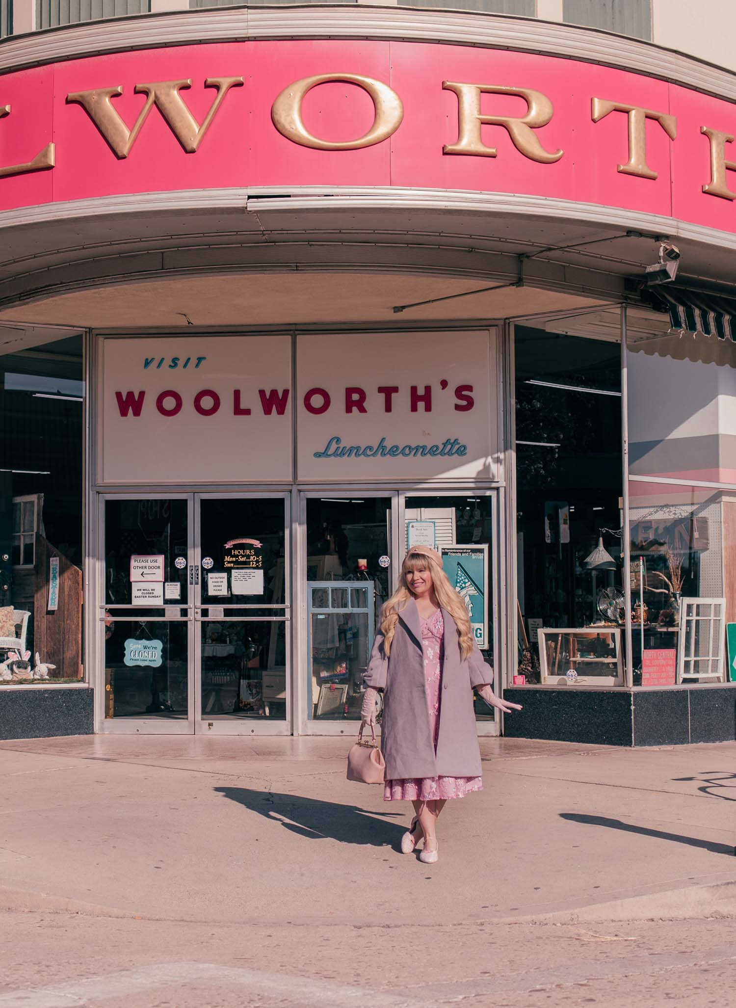 Feminine Fashion Blogger Elizabeth Hugen of Lizzie in Lace styles a pink Mrs. Maisel Inspired Outfit and shares her Woolworth's Antique Haul