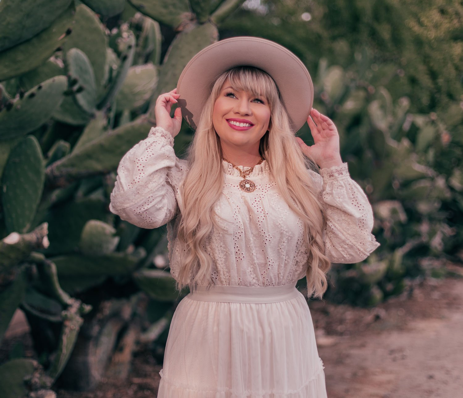 Fashion Blogger Elizabeth Hugen shares tips on How to Style a Rancher Hat in a Feminine Way and wears a Gigi Pip Monroe hat and a Sequin jewelry talisman necklace