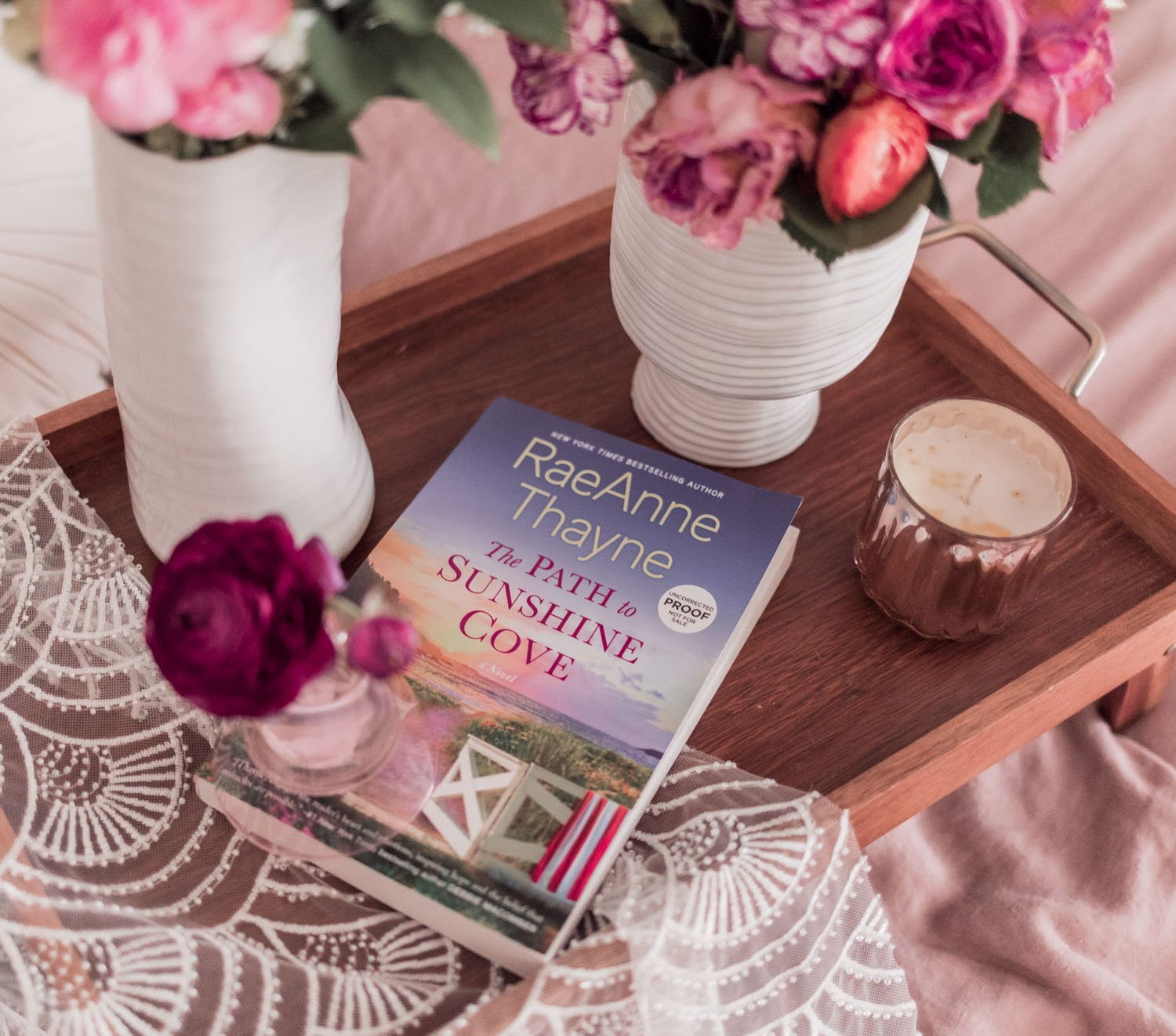 Feminine blogger Elizabeth Hugen of Lizzie in Lace shares her favorite spring books including The Path to Sunshine Cove