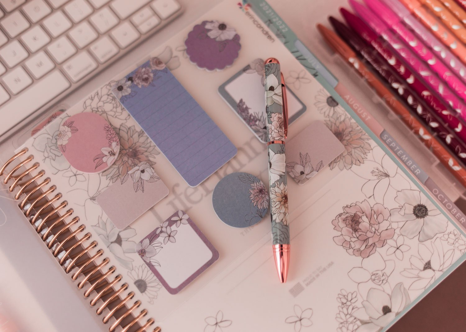 Feminine fashion blogger Elizabeth Hugen shares 3 tips for success when doing a mid-year goal check in along with her favorite Erin Condren LifePlanner and planner accessories