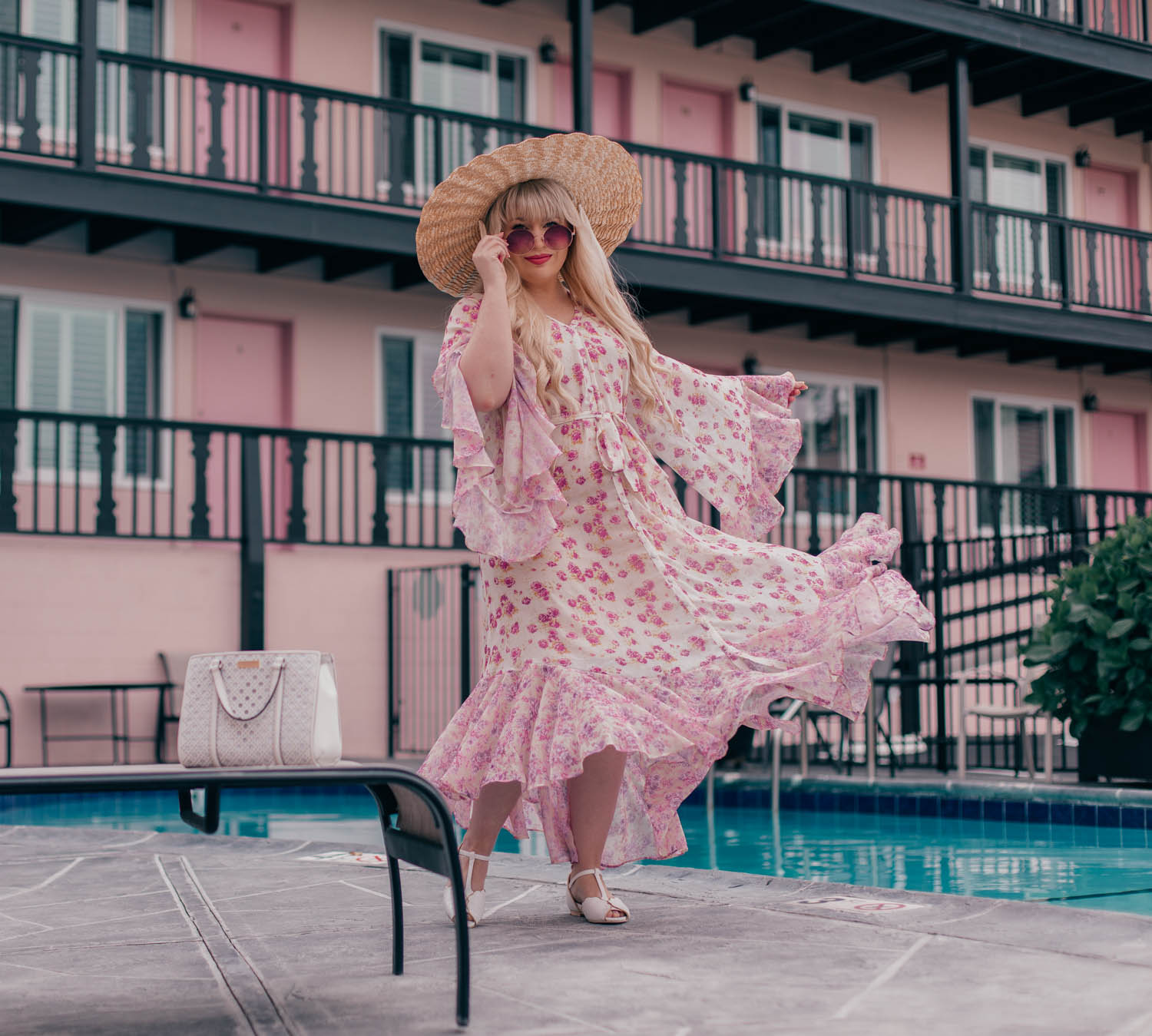 Feminine fashion blogger Elizabeth Hugen of Lizzie in Lace shares her favorite beach dress including a gorgeous floral Chicwish dress for summer