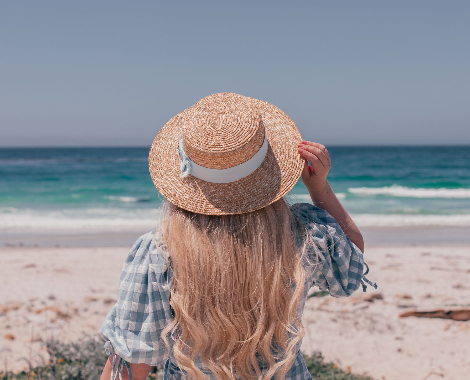 Feminine fashion blogger Elizabeth Hugen of Lizzie in Lace shares 3 Feminine Summer Hair Accessories to Wear Now including this gorgeous feminine boater hat