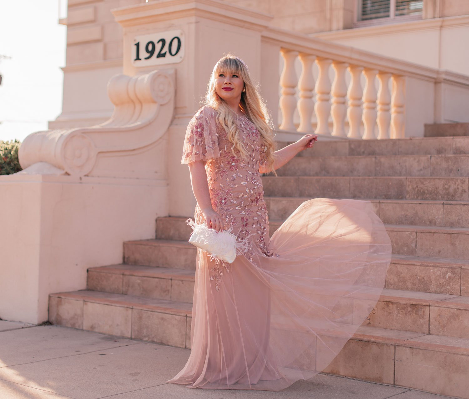 Feminine Fashion Blogger Elizabeth Hugen of Lizzie in Lace shares her favorite Summer Wedding Guest Dresses including this gorgeous pink Adrianna Papell dress