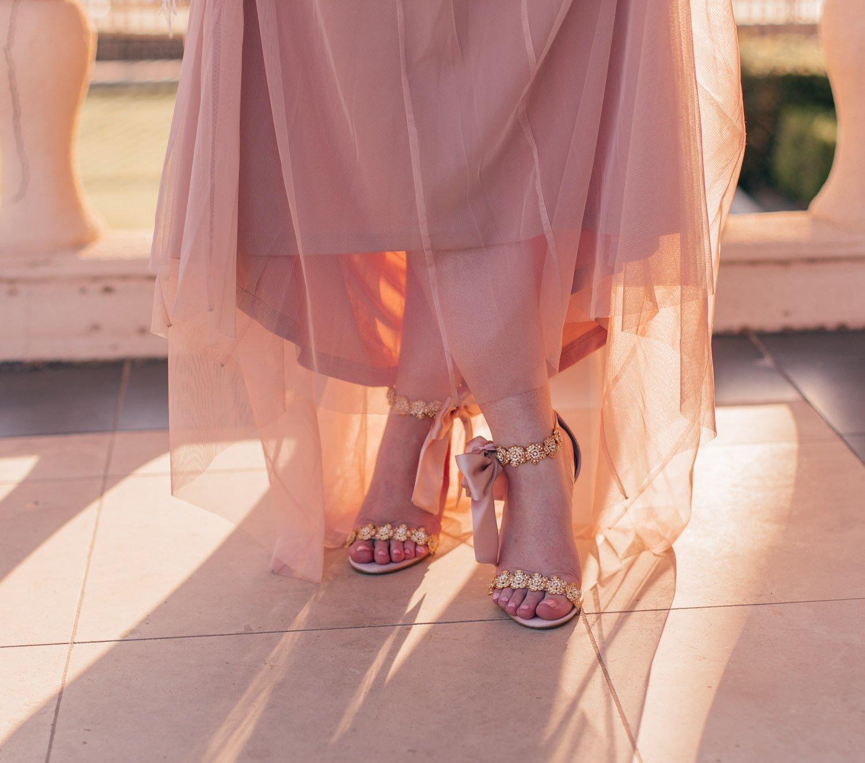 Feminine Fashion Blogger Elizabeth Hugen of Lizzie in Lace shares her favorite Summer Wedding Guest Dresses including a pink Bella belle heels