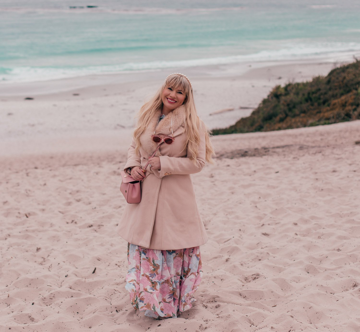 Fashion Blogger Elizabeth Hugen of Lizzie in Lace shares what to do in Carmel by-the-sea and includes her favorite feminine travel outfit ideas like this Chicwish coat and floral dress