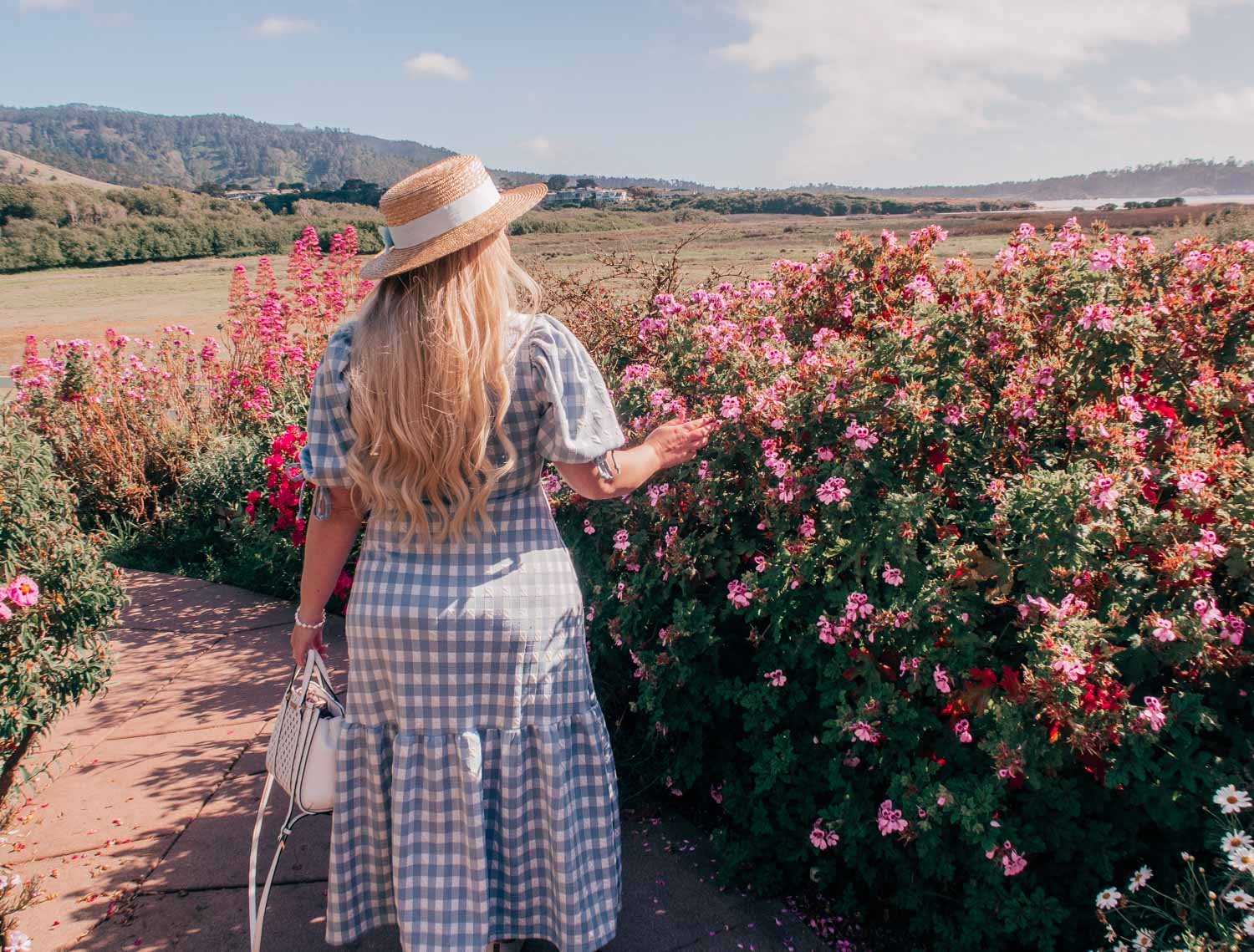 Fashion Blogger Elizabeth Hugen of Lizzie in Lace shares what to do in Carmel by-the-sea and includes her favorite feminine travel outfit ideas like this River Island blue Gingham Dress