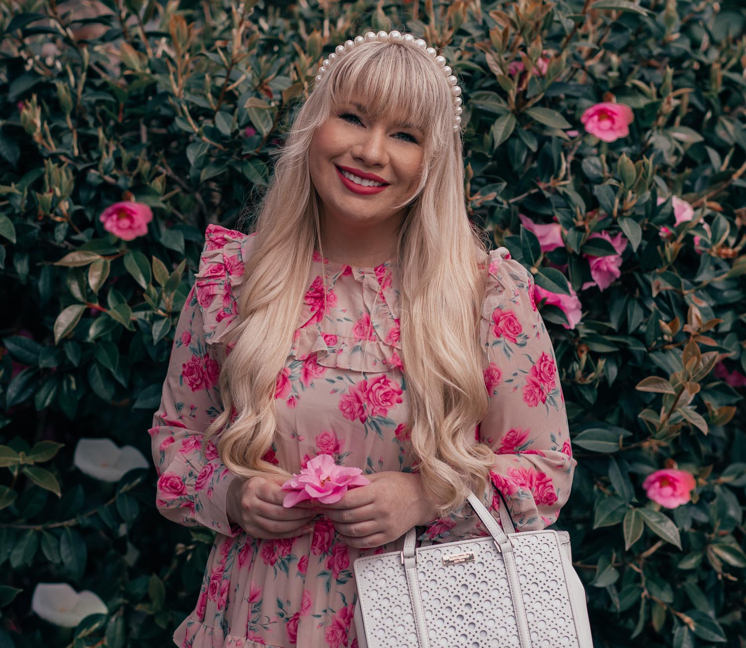 Feminine Fashion Blogger Elizabeth Hugen of Lizzie in Lace shares how to wear the statement collar trend along with a summer outfit including a pink floral chicwish dress and lele sadoughi pearl headband