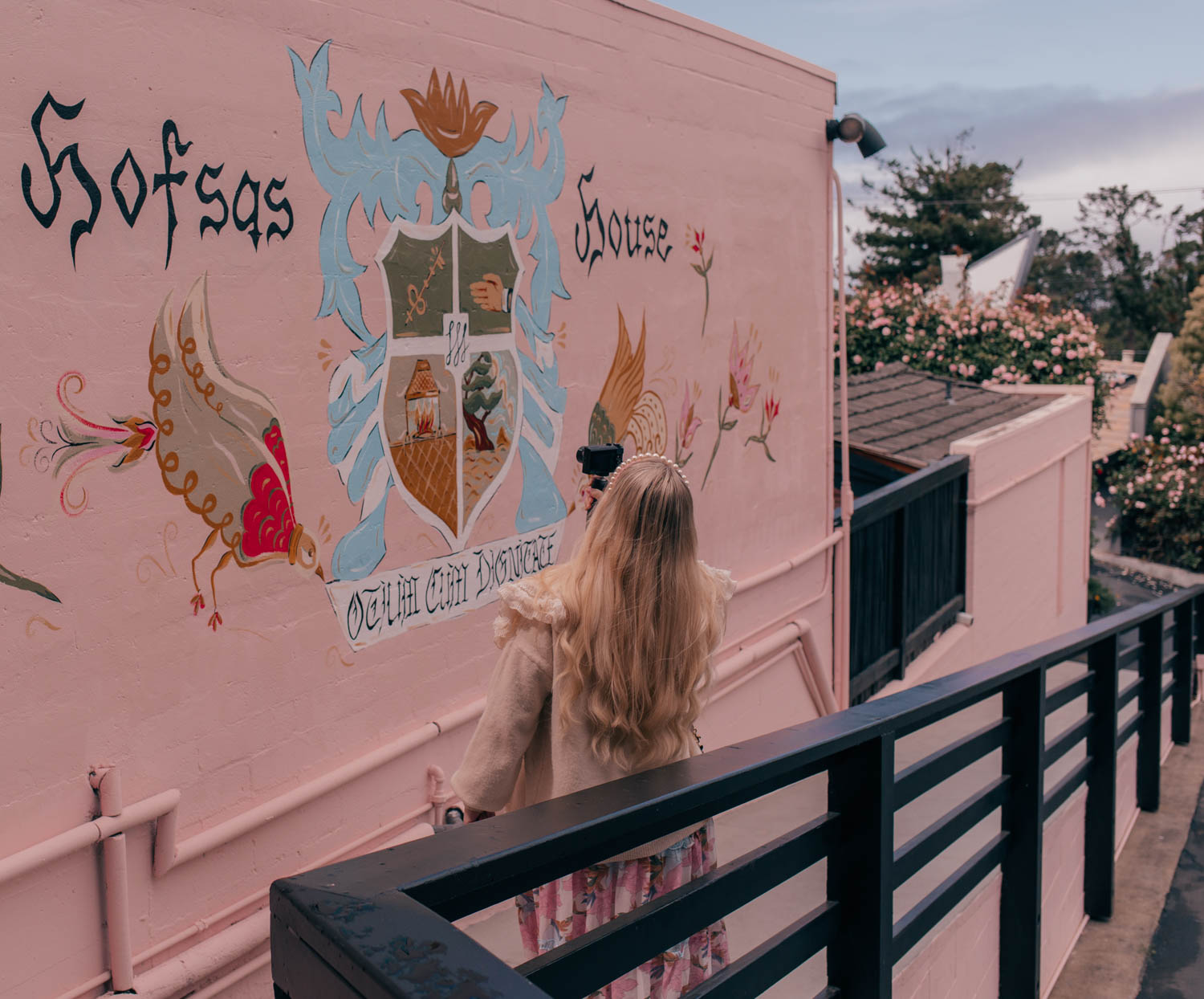 Feminine fashion blogger Elizabeth Hugen of Lizzie in Lace shares where to stay in Carmel by-the-sea along with a tour of the gorgeous property of Hofsas House Hotel, the prettiest pink hotel
