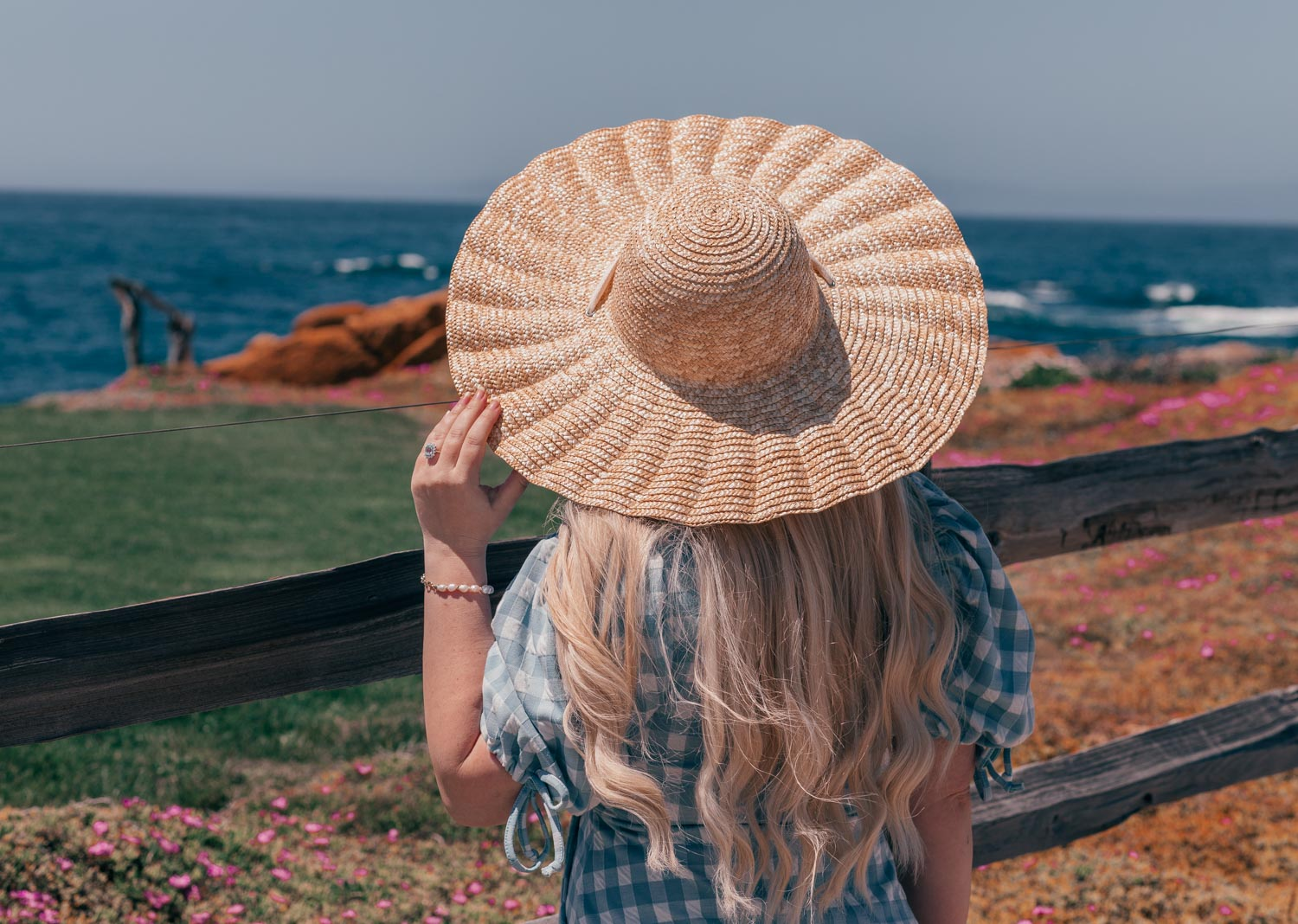 Fashion Blogger Elizabeth Hugen of Lizzie in Lace shares what to do in Carmel by-the-sea and includes her favorite feminine travel outfit ideas like this River Island blue Gingham Dress and Lack of Color Dolce Scalloped Hat