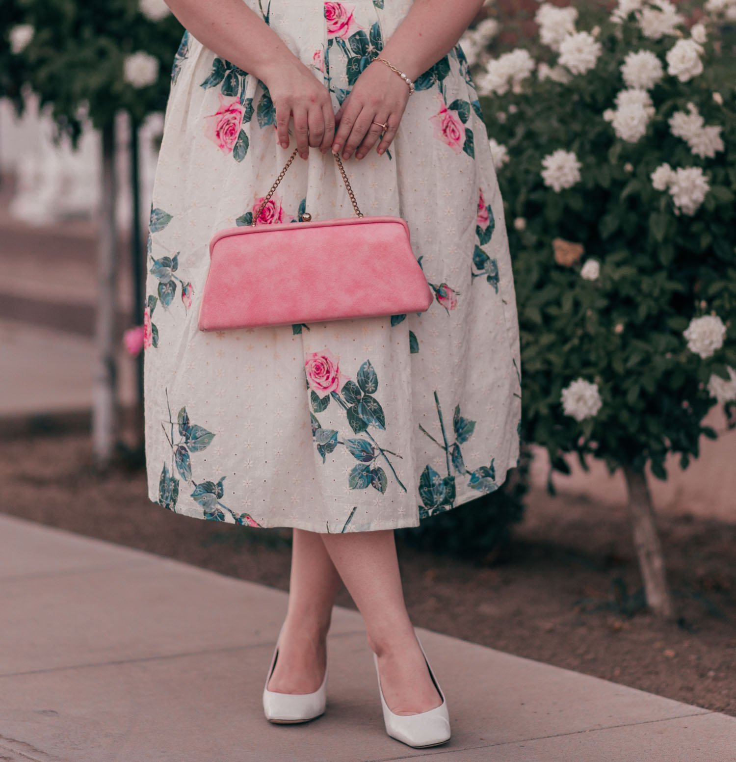 Feminine fashion blogger Elizabeth Hugen of Lizzie in Lace shares a pretty pastel vintage inspired floral skirt outfit with a Chicwish skirt and Franco Sarto heels
